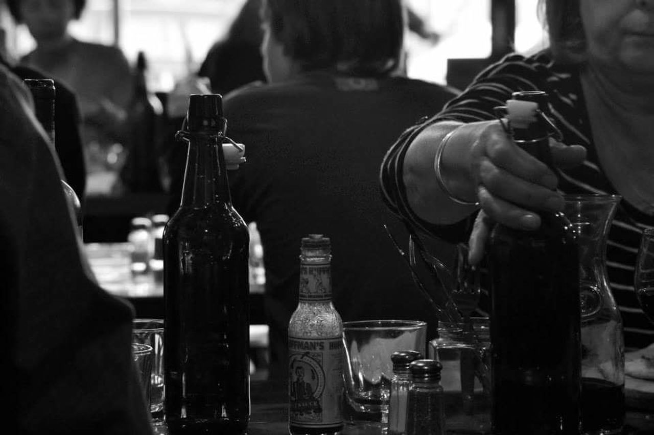 bottle, drink, alcohol, real people, beer - alcohol, focus on foreground, human body part, human hand, one person, drinking glass, close-up, bartender, men, indoors, day, freshness, people