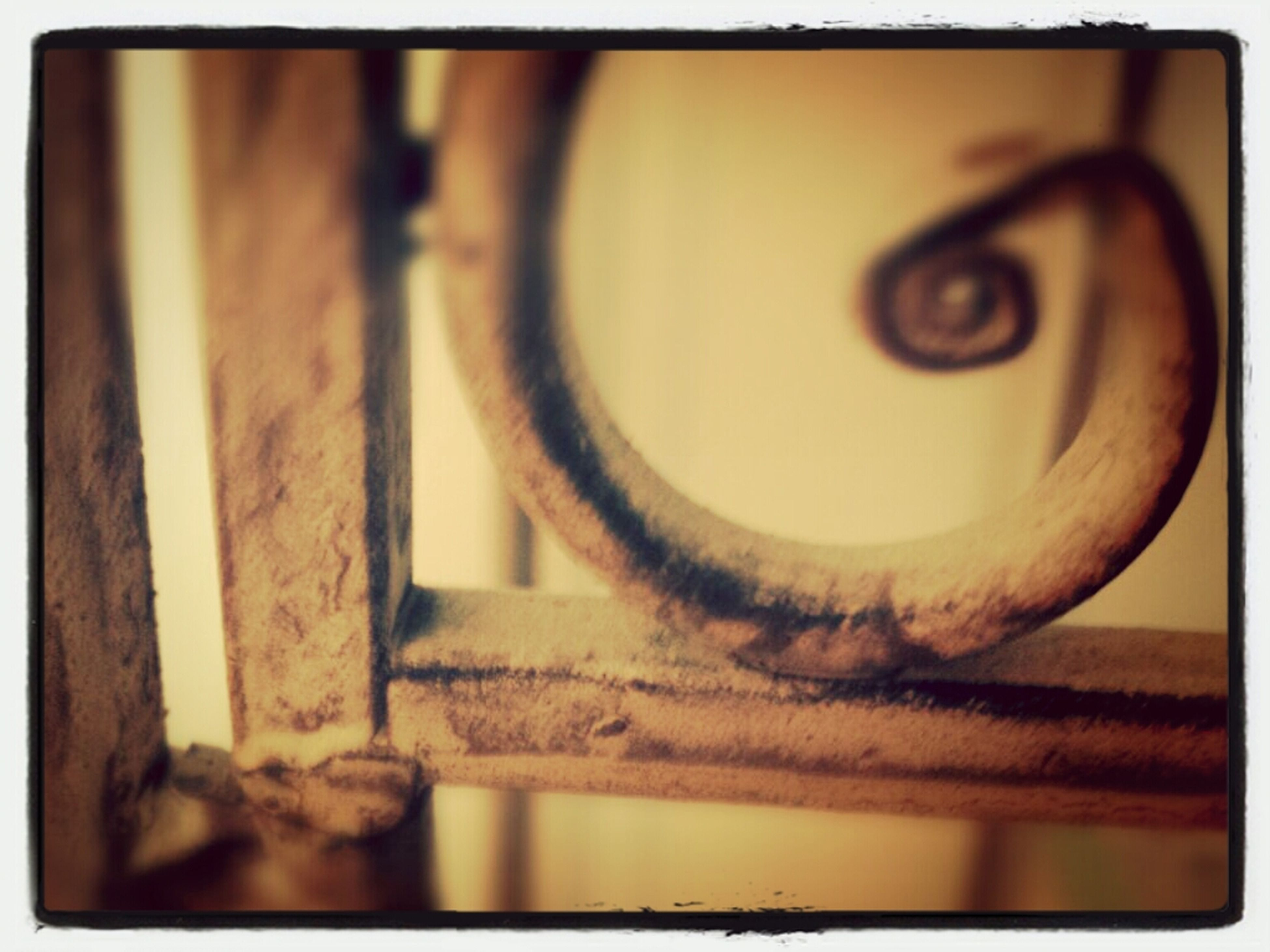 transfer print, auto post production filter, indoors, close-up, metal, focus on foreground, circle, metallic, no people, selective focus, still life, rusty, table, day, built structure, old, railing, shape, design, wood - material