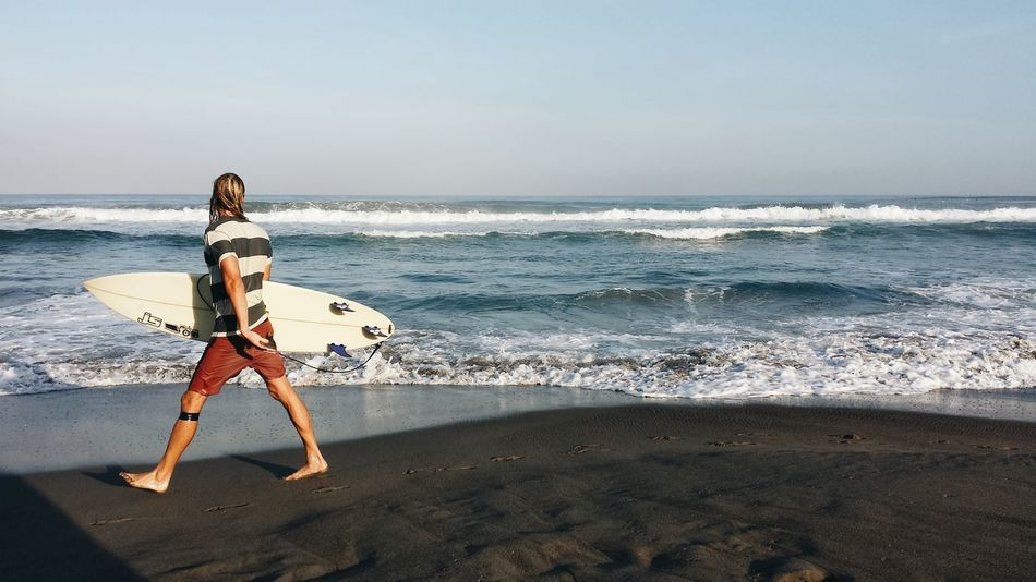 Photo was taken in La Union, Philippines Beach Sea Sand Full Length Coastline Outdoors Walking One Person Standing Beauty Philippines One Woman Only Vacations Adults Only People Beauty In Nature Adult Wave Launion Only Women Nature SurfScenics First Eyeem Photo EyeEmNewHere EyeEmNewHere EyeEmNewHere