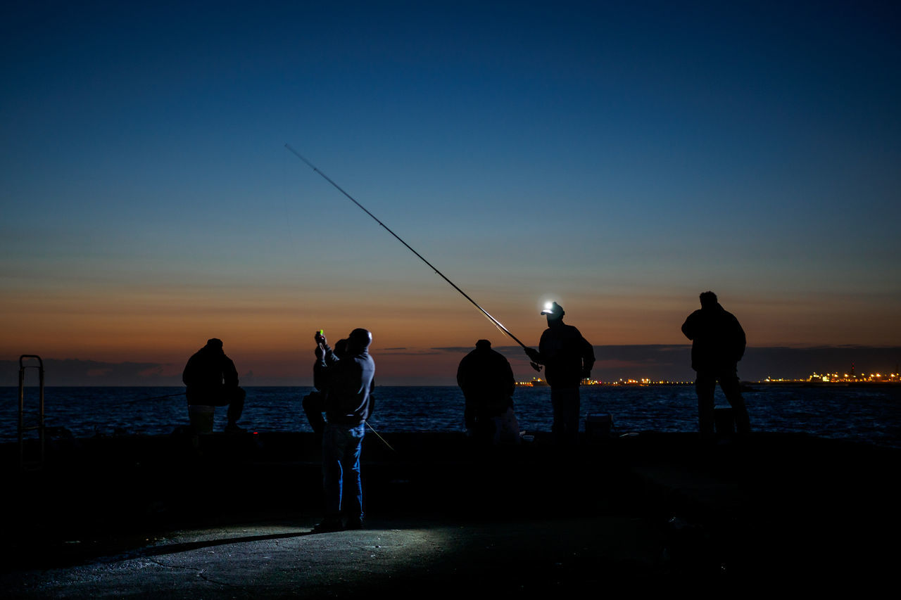 fisherman @ night Beauty In Nature Fishing Fishing Pole Fivedaysporto Full Length Horizon Over Water Leisure Activity Lifestyles Men Nature Outdoors People Real People Scenics Sea Silhouette Sky Standing Sunset Togetherness Water Weekend Activities