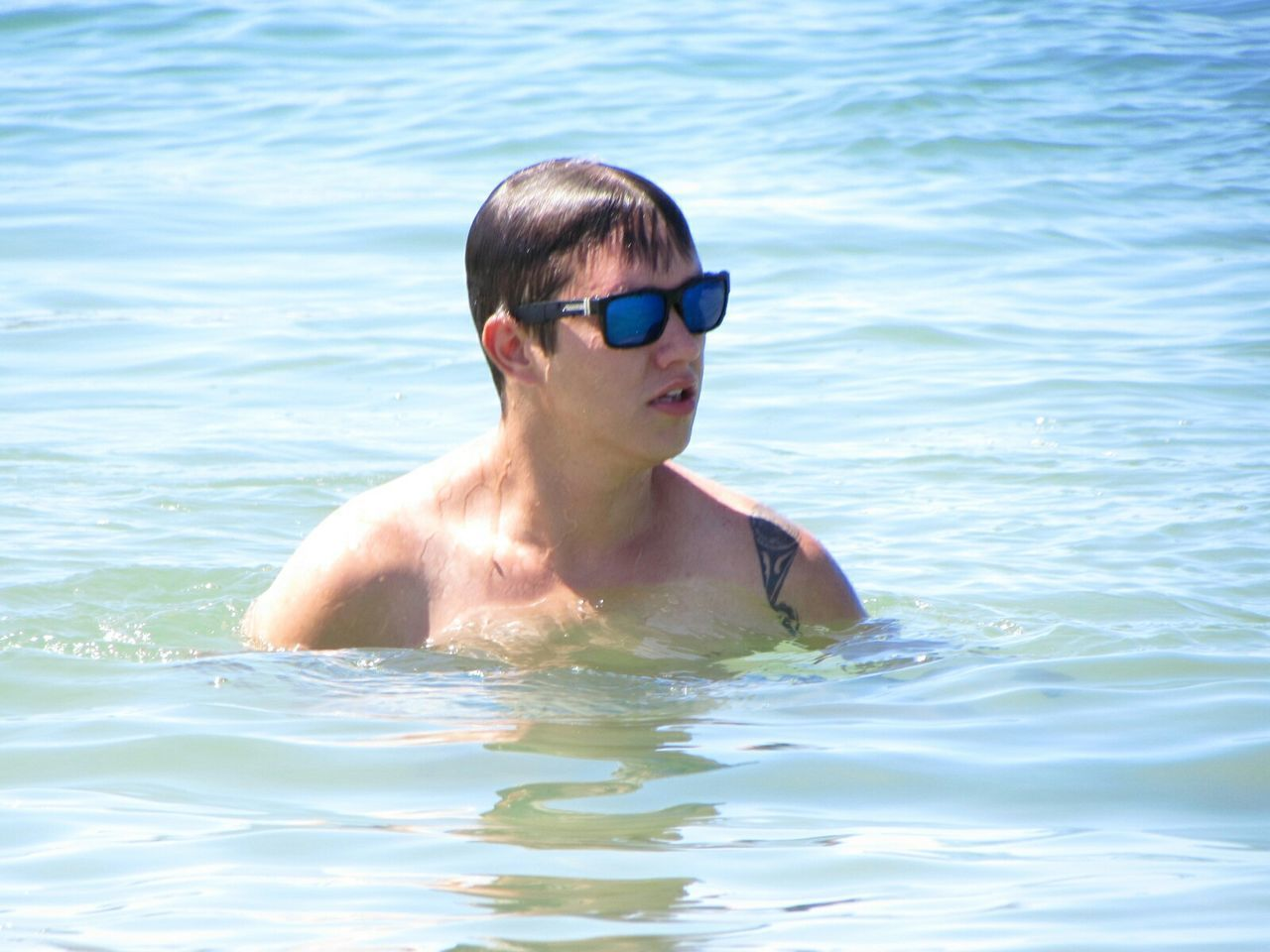water, waterfront, swimming, person, portrait, leisure activity, young adult, rippled, looking at camera, lifestyles, shirtless, animal themes, sea, one animal, front view, young men, swimming pool, refreshment
