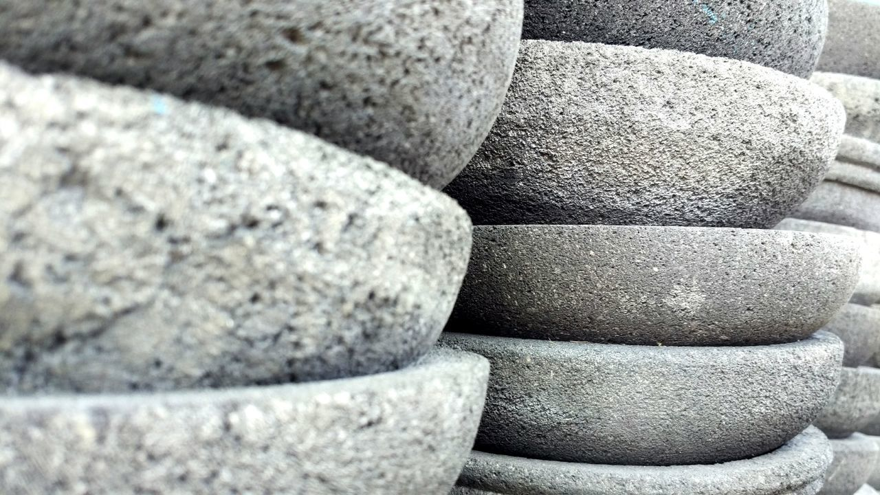 stack, stone - object, balance, stone material, gray, rock - object, textured, pebble, sport, large group of objects, no people, day, backgrounds, close-up, outdoors