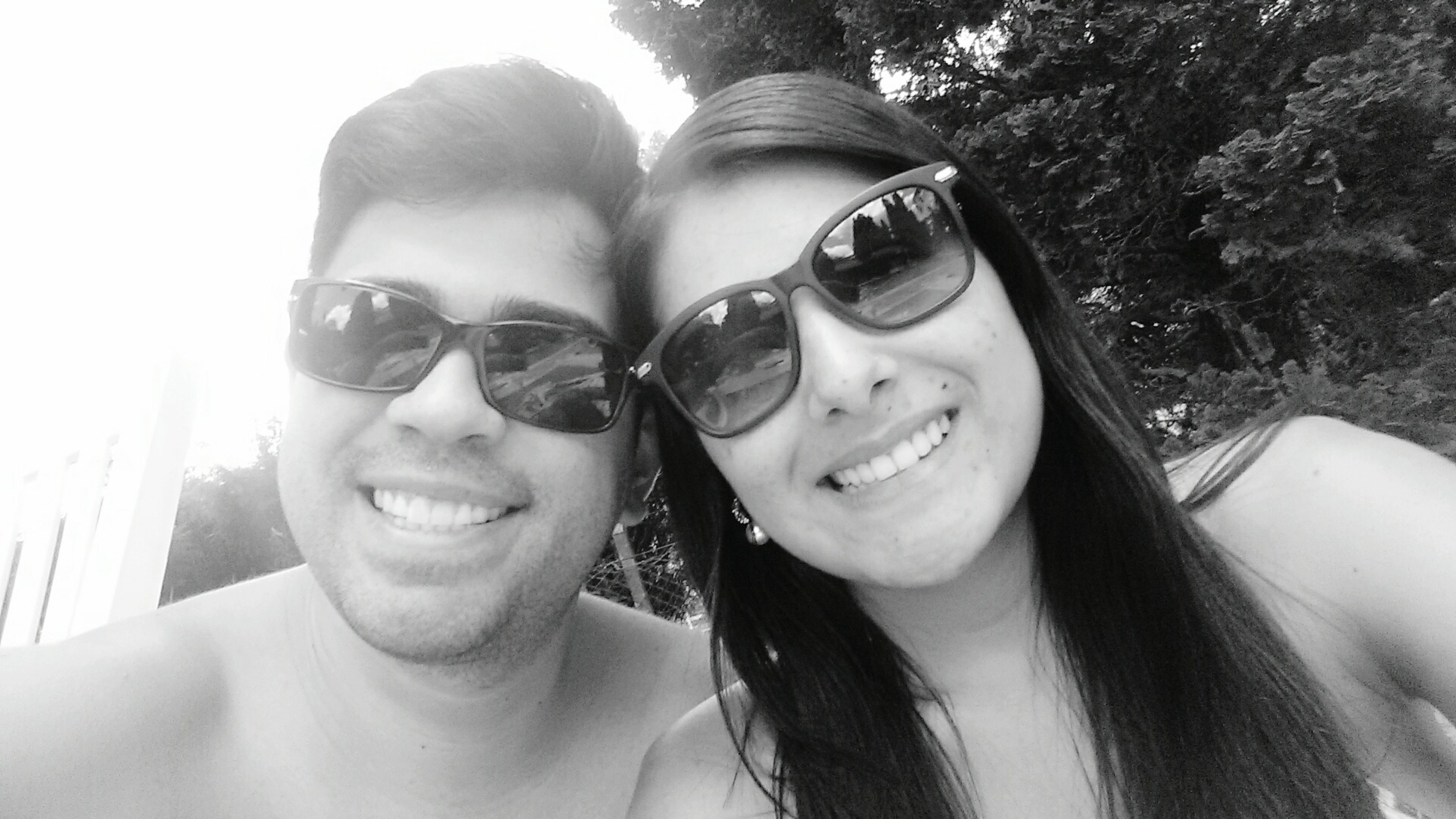 two people, sunglasses, young adult, friendship, happiness, togetherness, young couple, smiling, portrait, love, heterosexual couple, carefree, headshot, adult, outdoors, people, young women, bonding, adults only, city, cheerful, close-up, day, sky, nature
