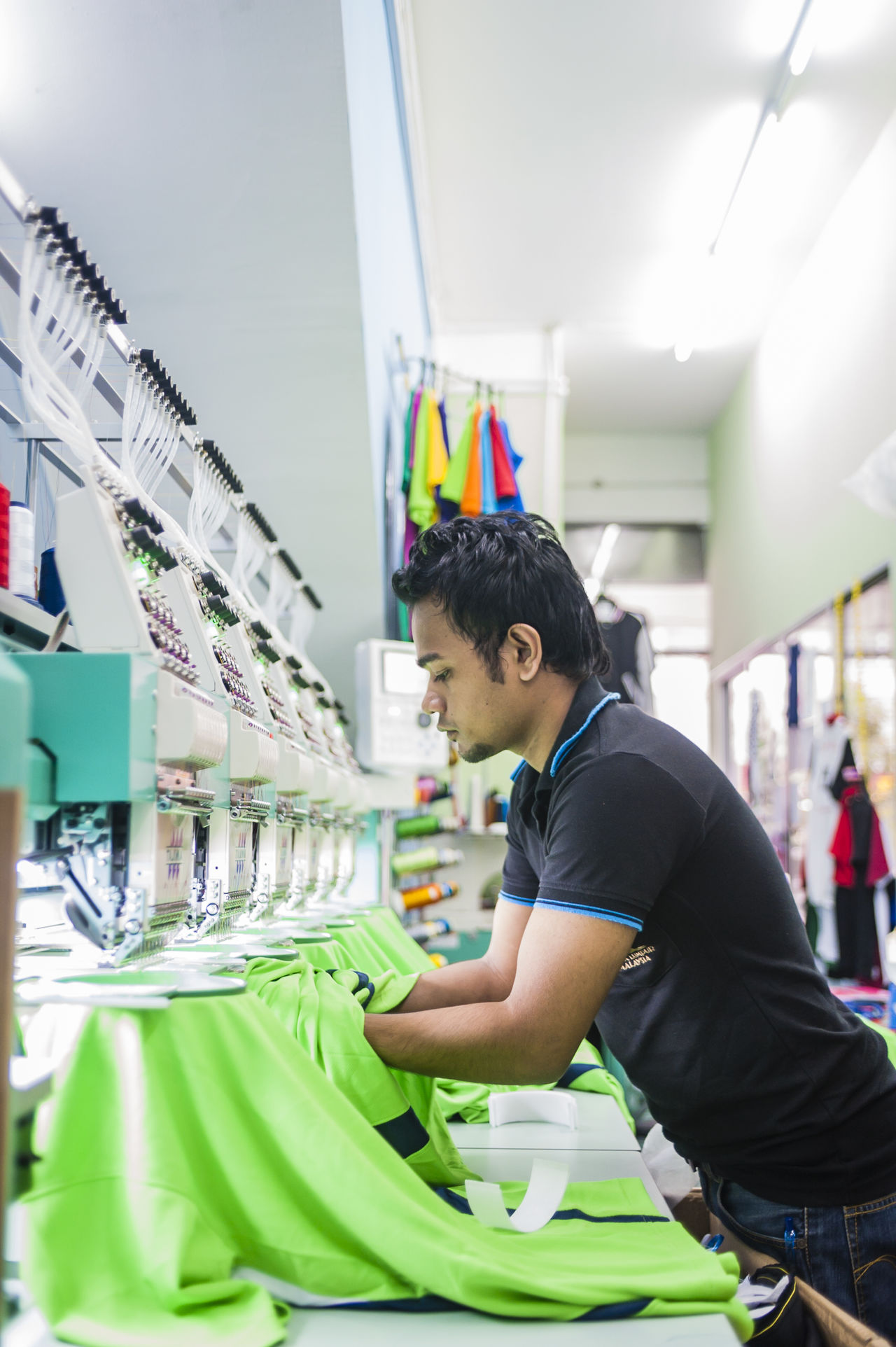 Business Embroidery Human Industrial Industry Machinery Machines Male Man Objects Occupation People Portrait Printing Sewing Machine Still Life Textile Threads Work Working