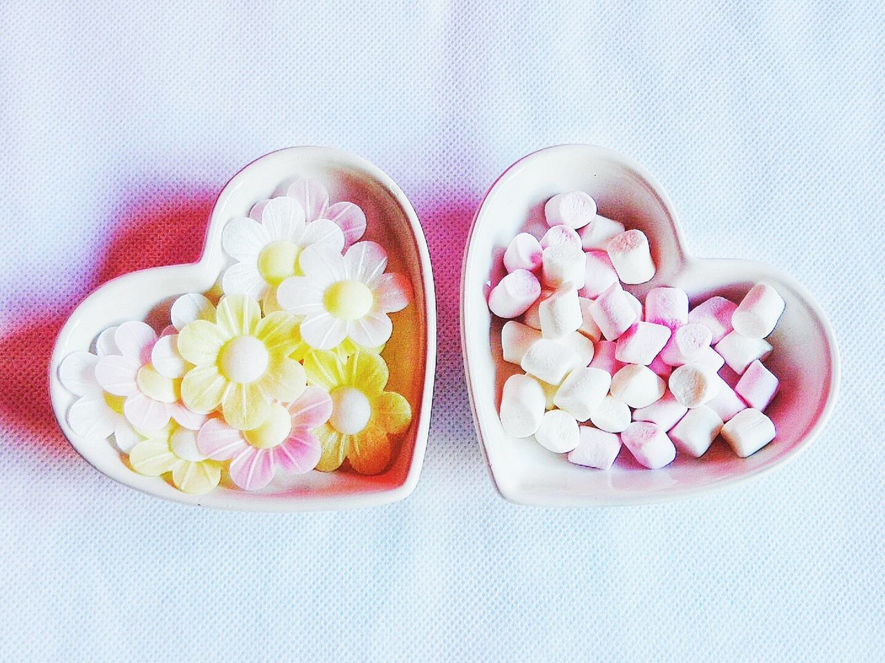 Directly Above View Of Flower Shape Candies And Marshmallows In Containers