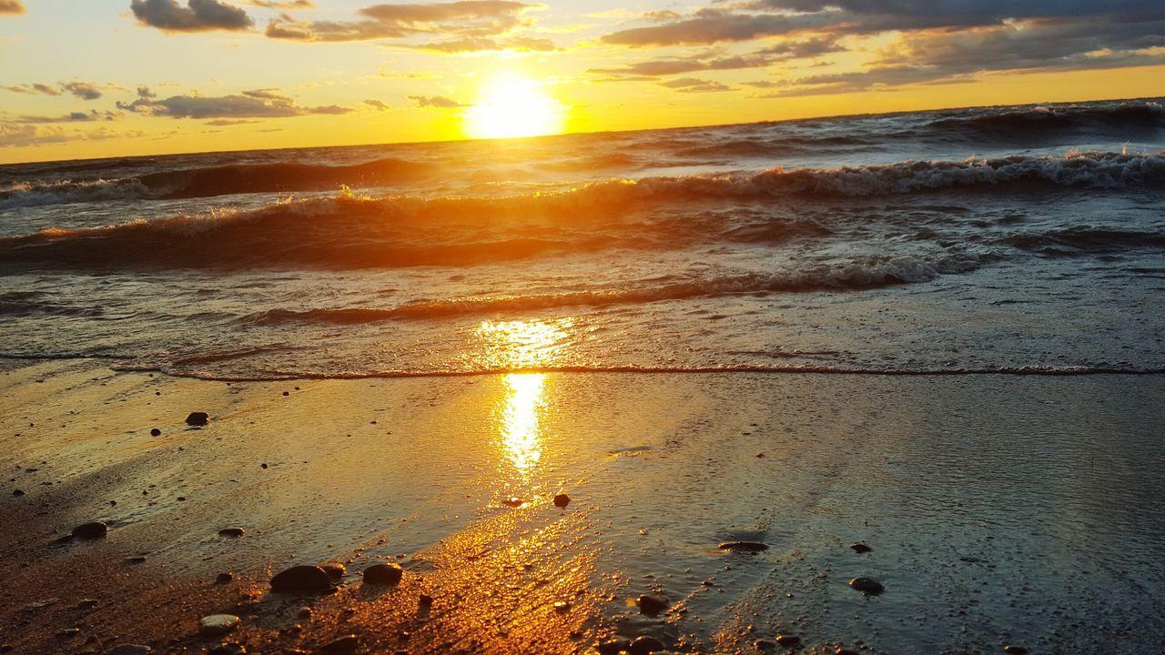 sunset, beauty in nature, sea, water, nature, sun, scenics, beach, reflection, orange color, tranquility, tranquil scene, sky, sunlight, cloud - sky, outdoors, no people, wave, sand, horizon over water, day