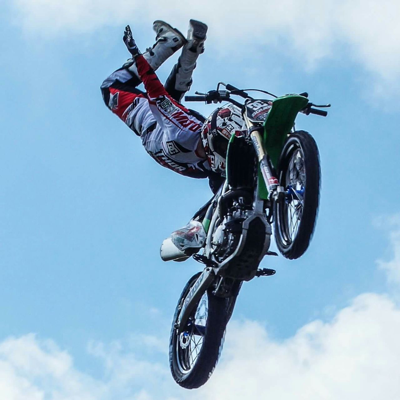 extreme sports, danger, stunt, low angle view, risk, cloud - sky, competitive sport, mid-air, skill, sport, competition, men, jumping, sky, adventure, motorcycle, activity, motocross, motion, outdoors, sports helmet, day, headwear, helmet, one person, motorsport, professional sport, real people, sports track, sports race, people, one man only, only men, athlete, adult, stunt person, adults only