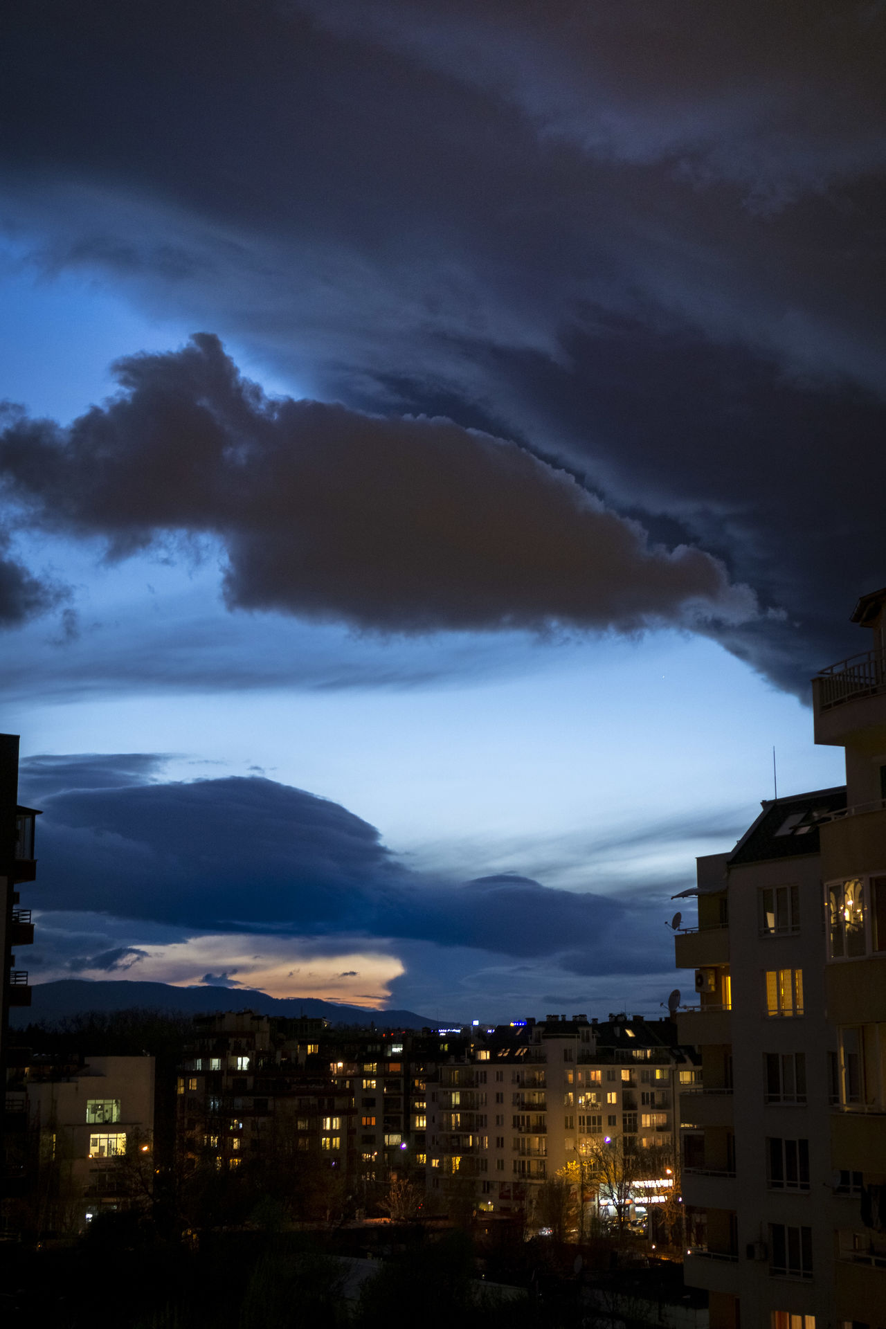 After Sunset Alien Architecture Beauty In Nature Building Exterior Cityscape Clouds Illuminated Iwanttobelieve Night Residential Building Theyarehere UFO