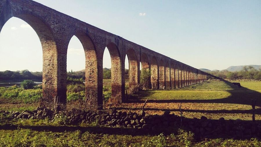 Bridge - Man Made Structure Viaduct Connection Outdoors No People Sky Grass Day Nature Railway Bridge Architecture