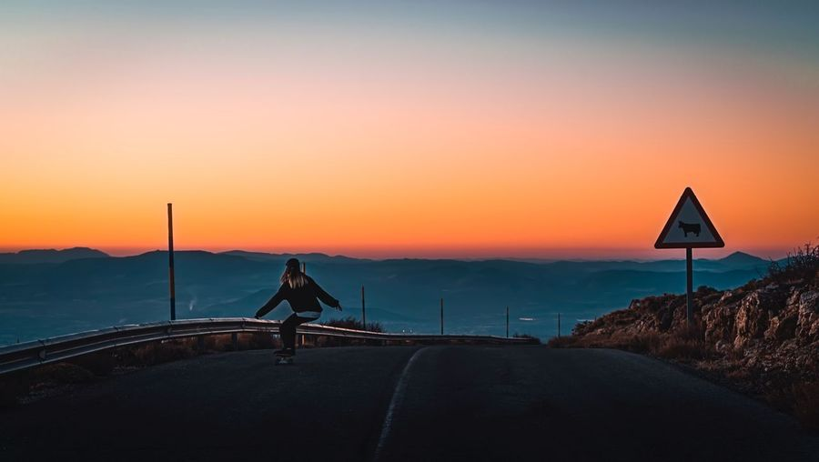 Sunset Sunset One Person Road Scenics Silhouette Full Length Real People Beauty In Nature Nature Lifestyles Sky Transportation Outdoors Mountain Sea Landscape Men Day People