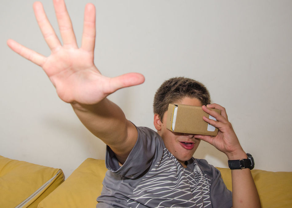 Cardboard Google Virtual Reality Simulator Hands-free Device Iphone Android Downloading technology open source smart Phone Modern Candid Mobile Phone Tellephone Amazed Amazing Android Carboard Cardboard Box Electronics  Emotions Future Google Cardboard Internet IPhone Modern Samsung Samsung S5 Smartphone Stonned Surprised Technology Virtual Virtual Reality Virtual Reality Simulator Vr Young Young Boy Youtube
