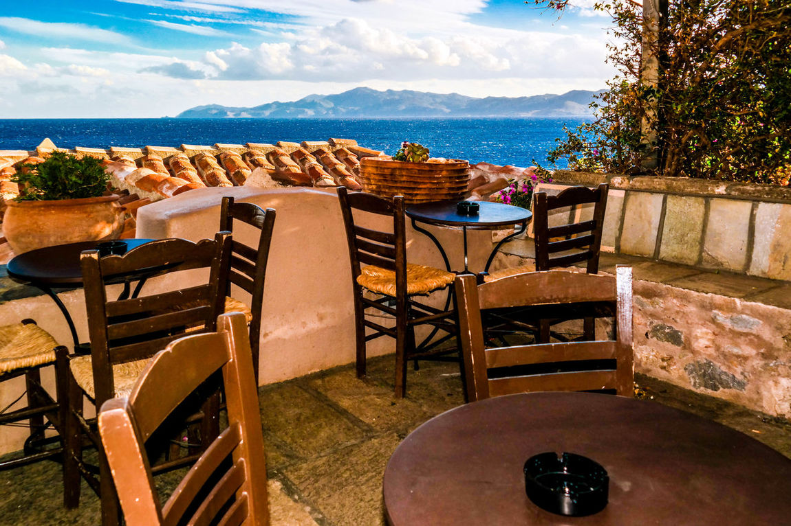 Absence Arrangement Chair Greece No People Relaxation Sea Sidewalk Cafe Sky Table Traveling