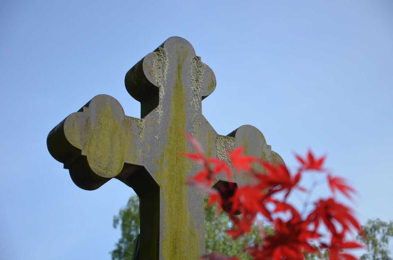 cemetery, tombstone, memorial, low angle view, no people, cross, close-up, day, spirituality, outdoors, clear sky, gravestone, sky