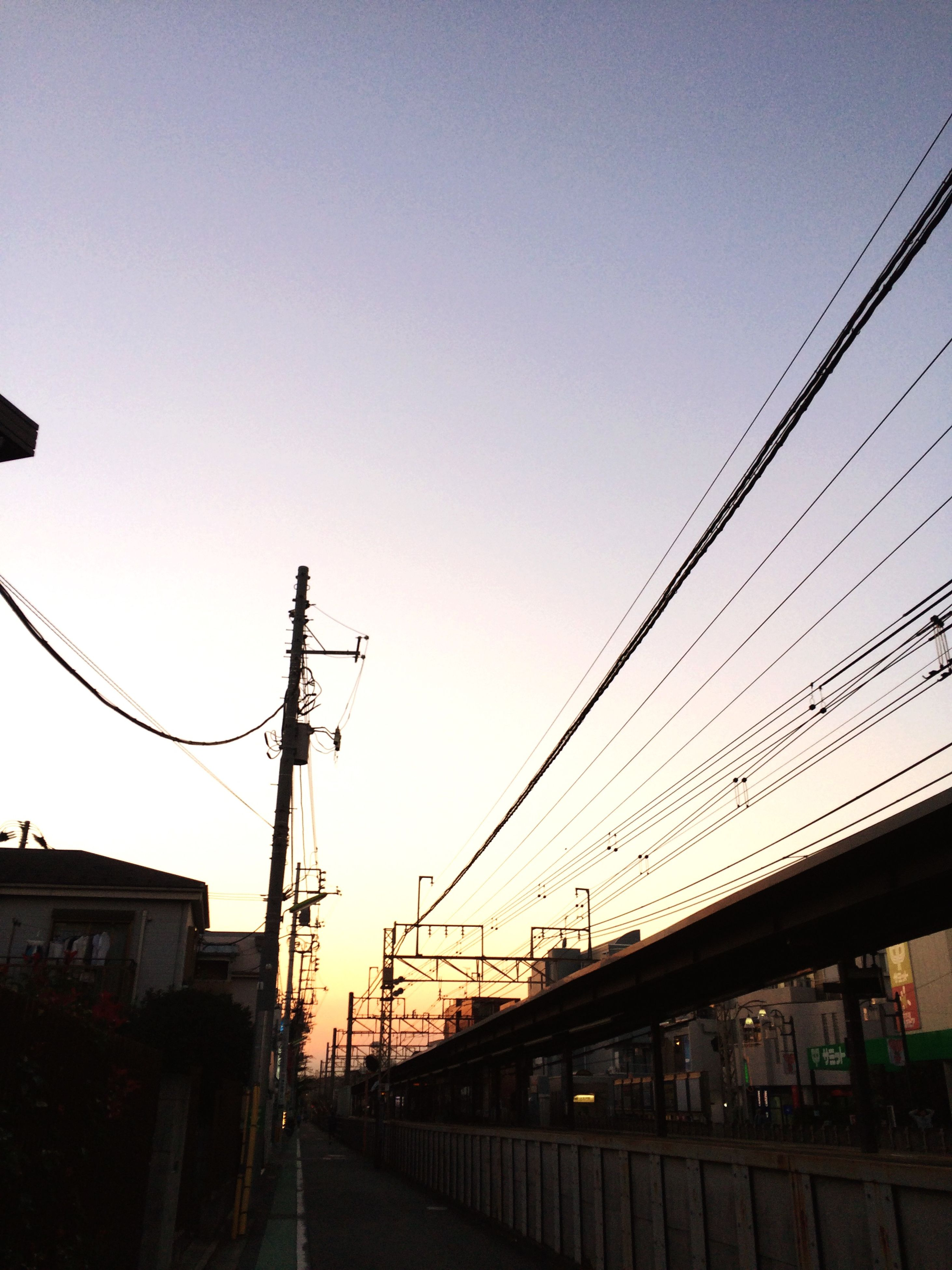 clear sky, power line, built structure, architecture, building exterior, connection, cable, electricity pylon, low angle view, electricity, power supply, copy space, technology, power cable, fuel and power generation, silhouette, city, sky, outdoors, sunset
