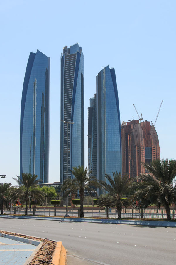 Skyscrapers of Abu Dhabi Abu Dhabi Arabic Architecture Building Exterior Built Structure City Clear Sky Day Ethiad Towers Faith Islam Long Modern Office Building Outdoors People Sheik Zayed Mosque Skyscraper Tall Tall - High Tower Tree United Arab Emirates Urban Skyline White Mosque