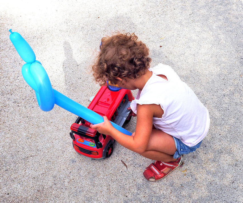 Blue And Red Sunset Blue Balloon Casual Clothing Child Playong With Toy Fire Engne Childhood Curly Hair Curly Haired Child Happiness High Angle View Playing Playtime... Red Toy Toy Fire Engine Toy Fire Truck Toystagram