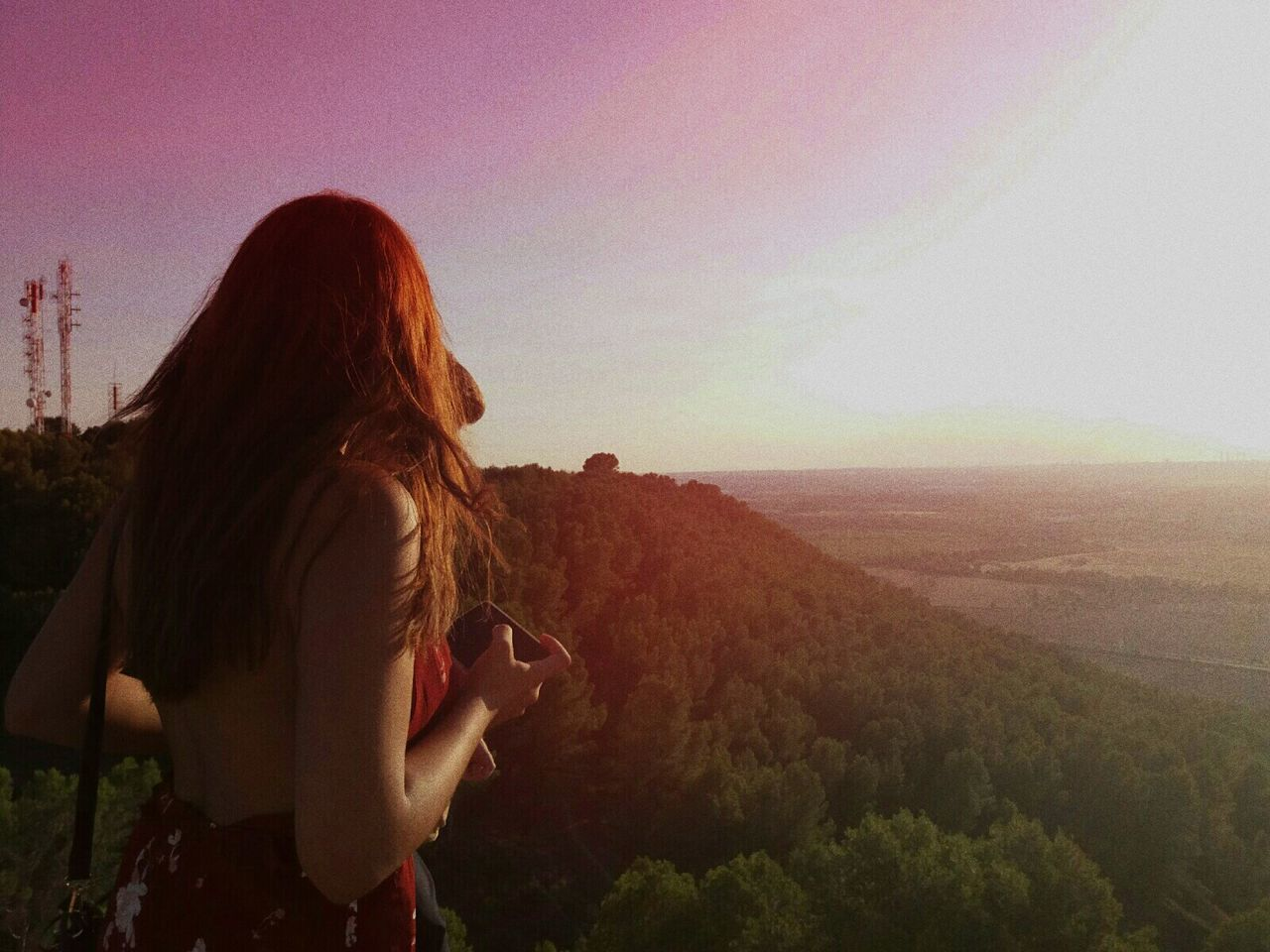 real people, rear view, one person, nature, leisure activity, landscape, long hair, standing, women, lifestyles, scenics, sky, outdoors, tranquility, beauty in nature, clear sky, sunset, adventure, day, tree, young adult, people