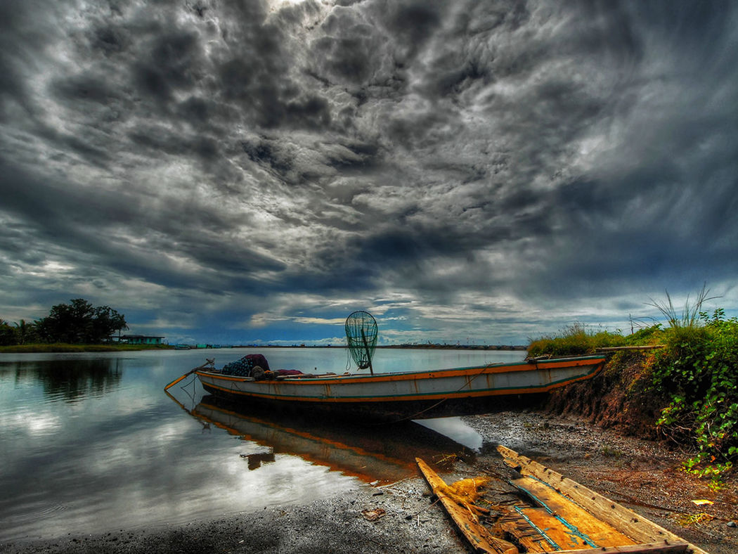 Atmospheric Mood Boat Cloud Cloudscape Cloudy Dramatic Sky Joel Yonzon Leading Moody Sky Nautical Vessel Orange Color Outdoors Power In Nature Sky Storm Cloud Sunset Tranquility