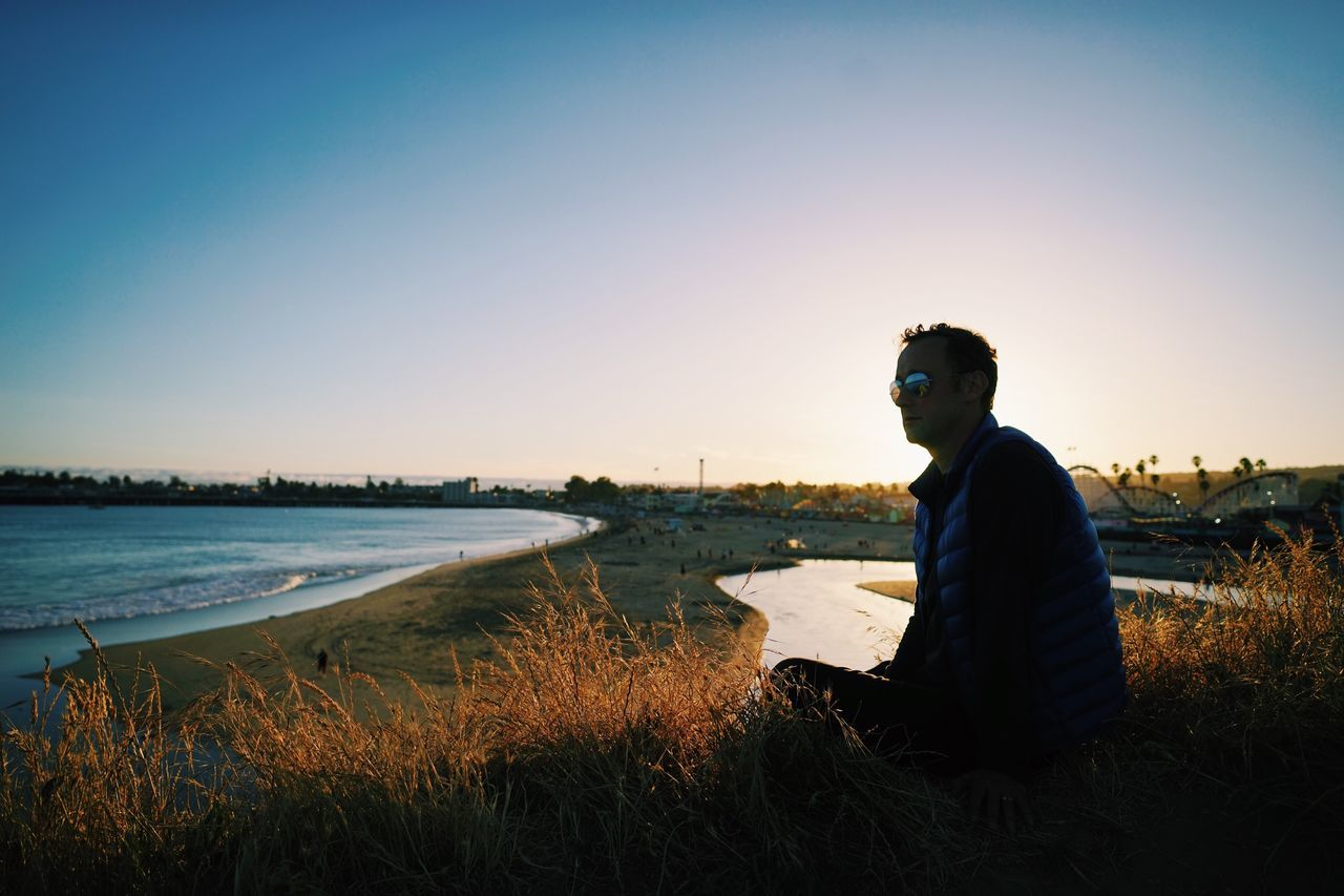 Santa Cruz, CA // Sunset Side View One Person Clear Sky Sea Sky Real People Outdoors Beach Sitting Standing Water Young Adult Nature One Man Only Day Adult People
