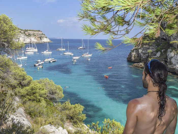 Amazed Holiday Pines Amazing Beach Beard Beauty In Nature Horizon Impressed Longhair Menorca One Person Rear View Scenics Sea Shirtless Standing Staring Summer Travel Destinations Tree Turqoise Vacations