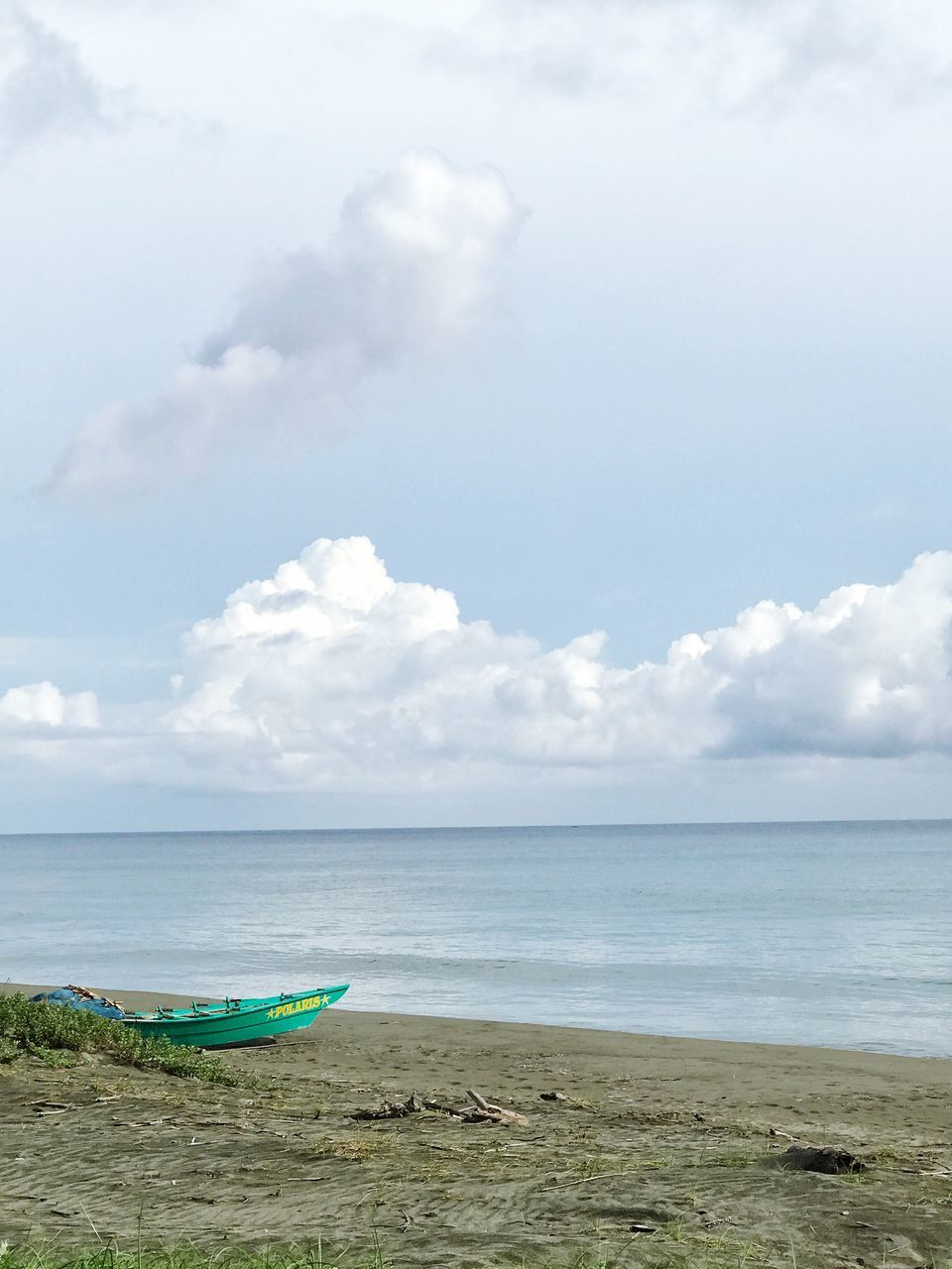 sea, beach, sky, horizon over water, water, cloud - sky, shore, sand, nature, beauty in nature, scenics, tranquility, day, nautical vessel, tranquil scene, outdoors, no people, outrigger
