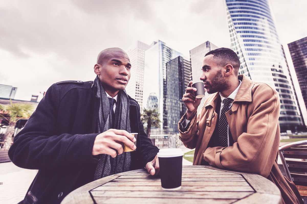 African Black Business Business Person Businessman City City Life Coffee Break Europe Finance District Formal Clothing France Lifestyles Men Outdoors Paris Paris,FR People Suit Team Tie Two People Urban Urban Scene Young Adult