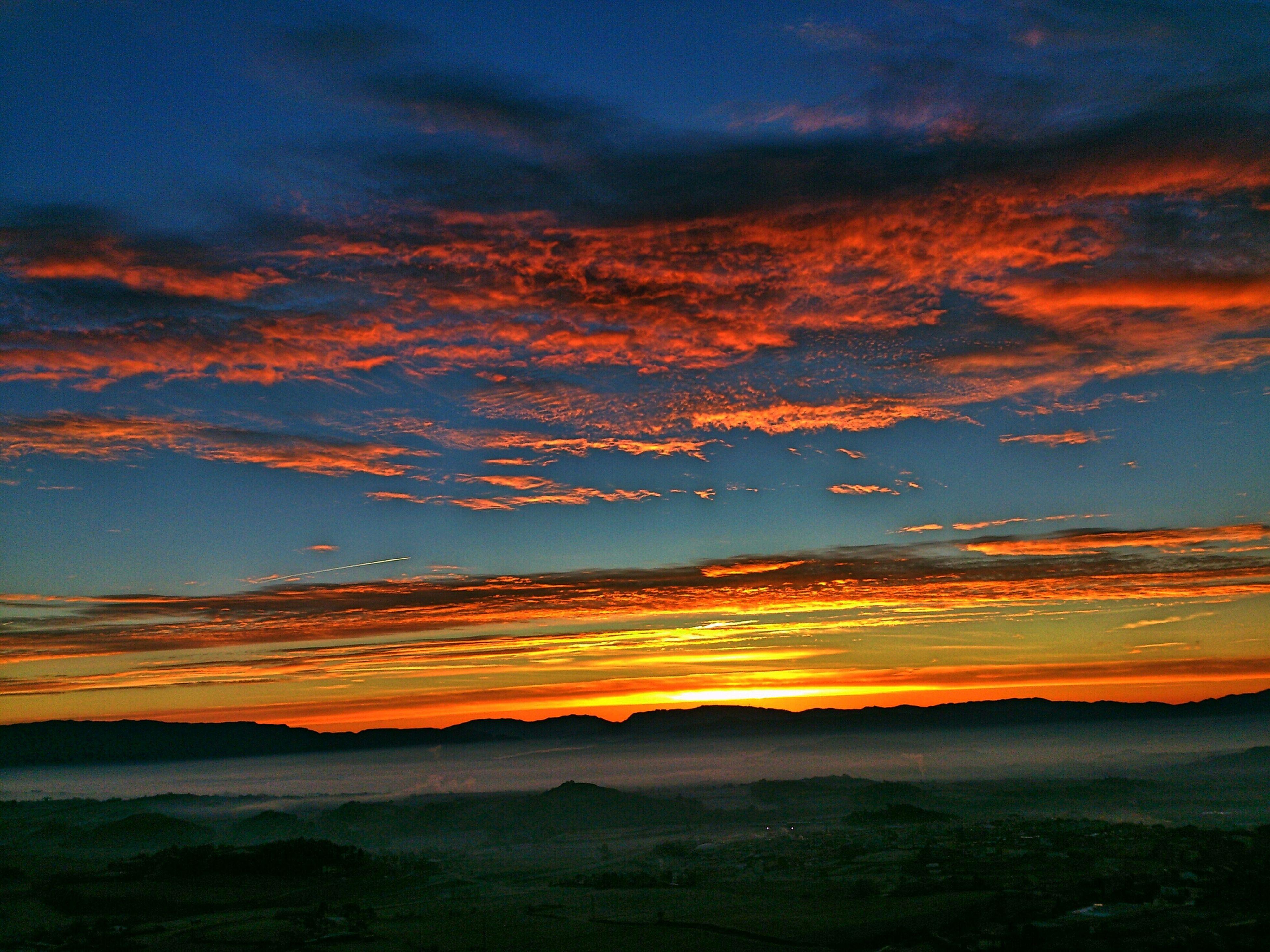 sunset, scenics, orange color, tranquil scene, tranquility, beauty in nature, sky, idyllic, dramatic sky, nature, landscape, cloud - sky, silhouette, majestic, cloud, mountain, non-urban scene, water, dusk, moody sky