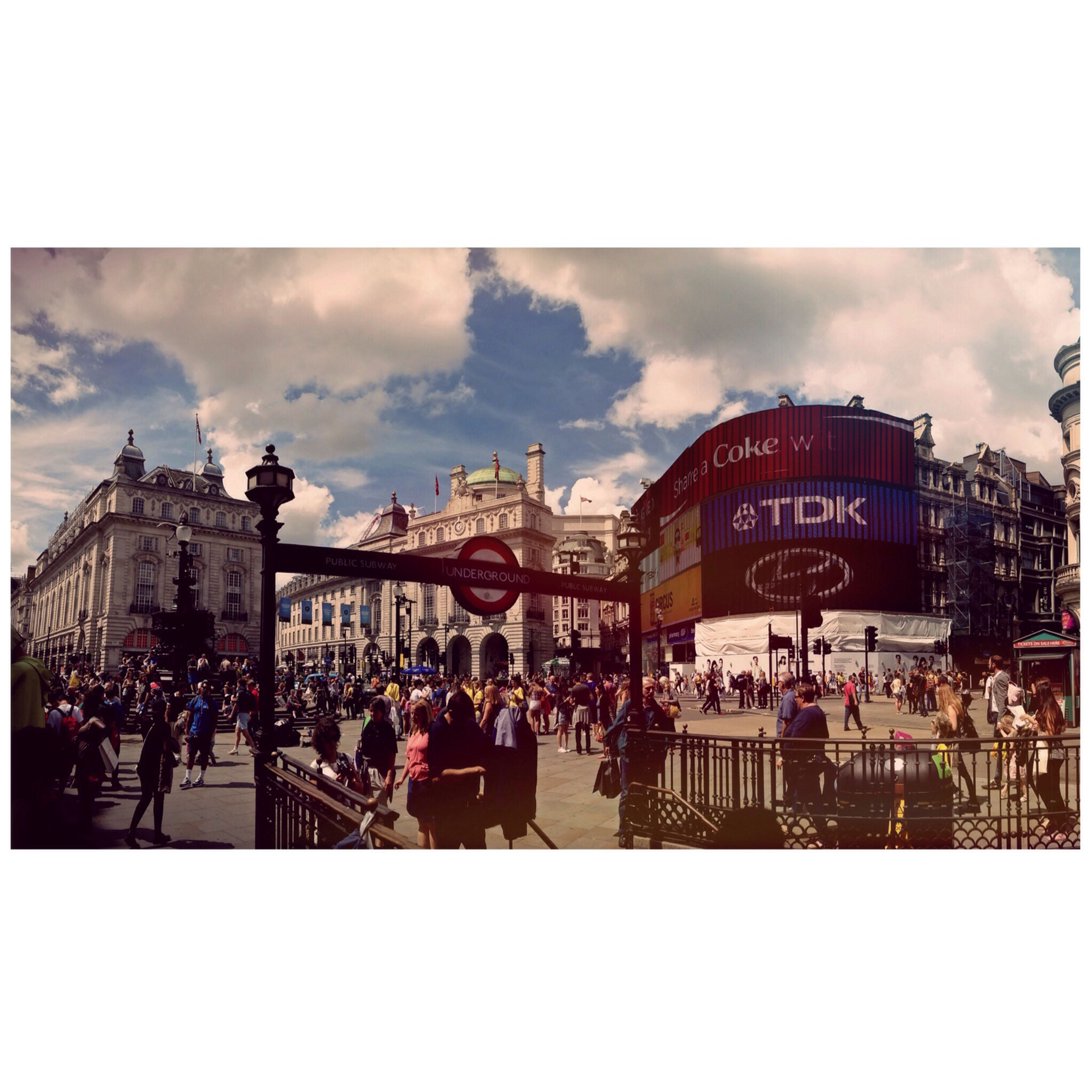 transfer print, architecture, building exterior, built structure, auto post production filter, large group of people, sky, city, person, men, cloud - sky, city life, mixed age range, lifestyles, cloud, town square, panoramic, outdoors, day