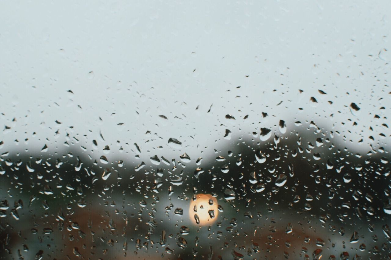Rainy days | Drop Wet Rain Window Raindrops Weather Water Sky Close-up Bokeh Headlights Taking Photos EyeEm Gallery Eye4photography  Nature