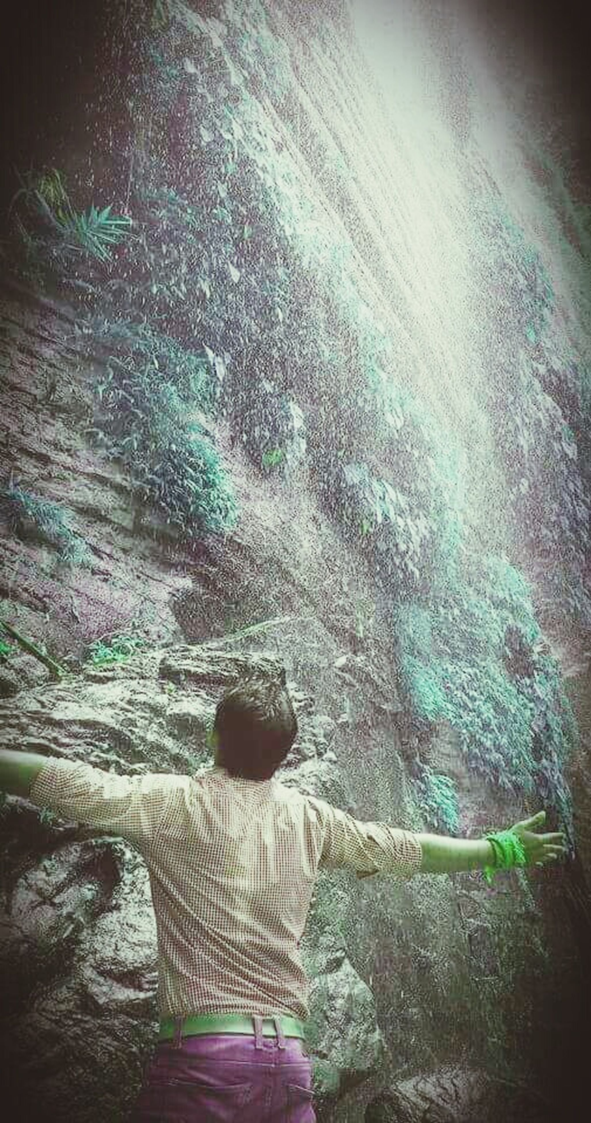 high angle view, textured, pattern, outdoors, wall - building feature, blue, art, art and craft, auto post production filter, creativity, day, multi colored, close-up, nature, unrecognizable person, sunlight, rock - object