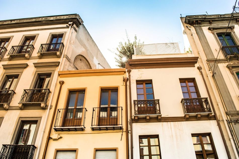 Building Exterior Architecture Window Low Angle View Built Structure Outdoors No People Sunlight Balcony Clear Sky City Day Residential Building Sky Cagliari Urban City Italy Sardinia Italy Sardegna EyeEm Travel Travel Destinations Travelling EyeEm Best Shots EyeEm Gallery