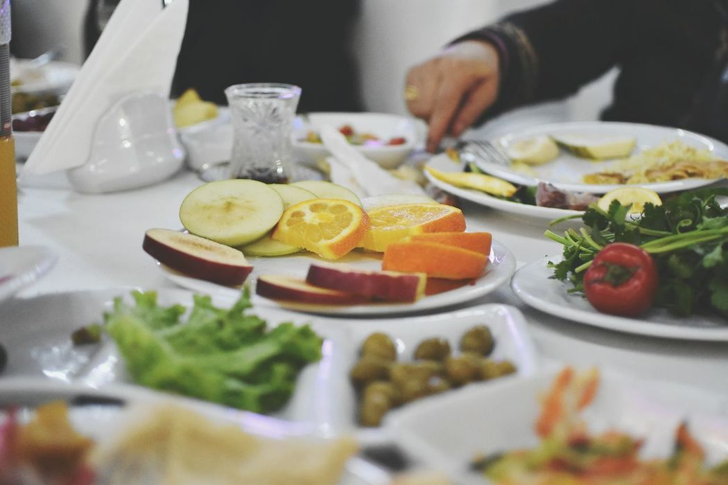 Food And Drink Lemon Selective Focus SLICE Table Healthy Eating Indoors  Food Fruit Citrus Fruit Freshness Lime Human Hand Close-up Human Body Part Ready-to-eat Dishes Dishes Set Delicious Chief Food Photography Resist EyeEm Diversity EyeEmNewHere