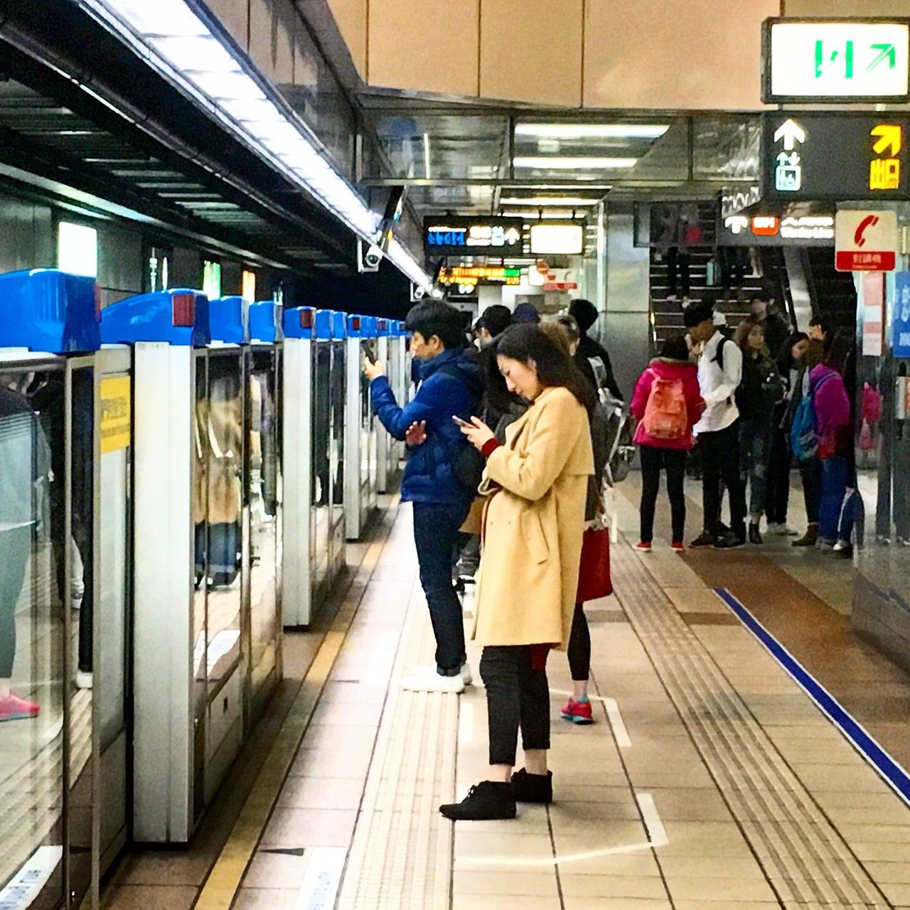 Mrt Riders Tuning Out Queue Lining Up Smartphone Reading EyeEmNewHere