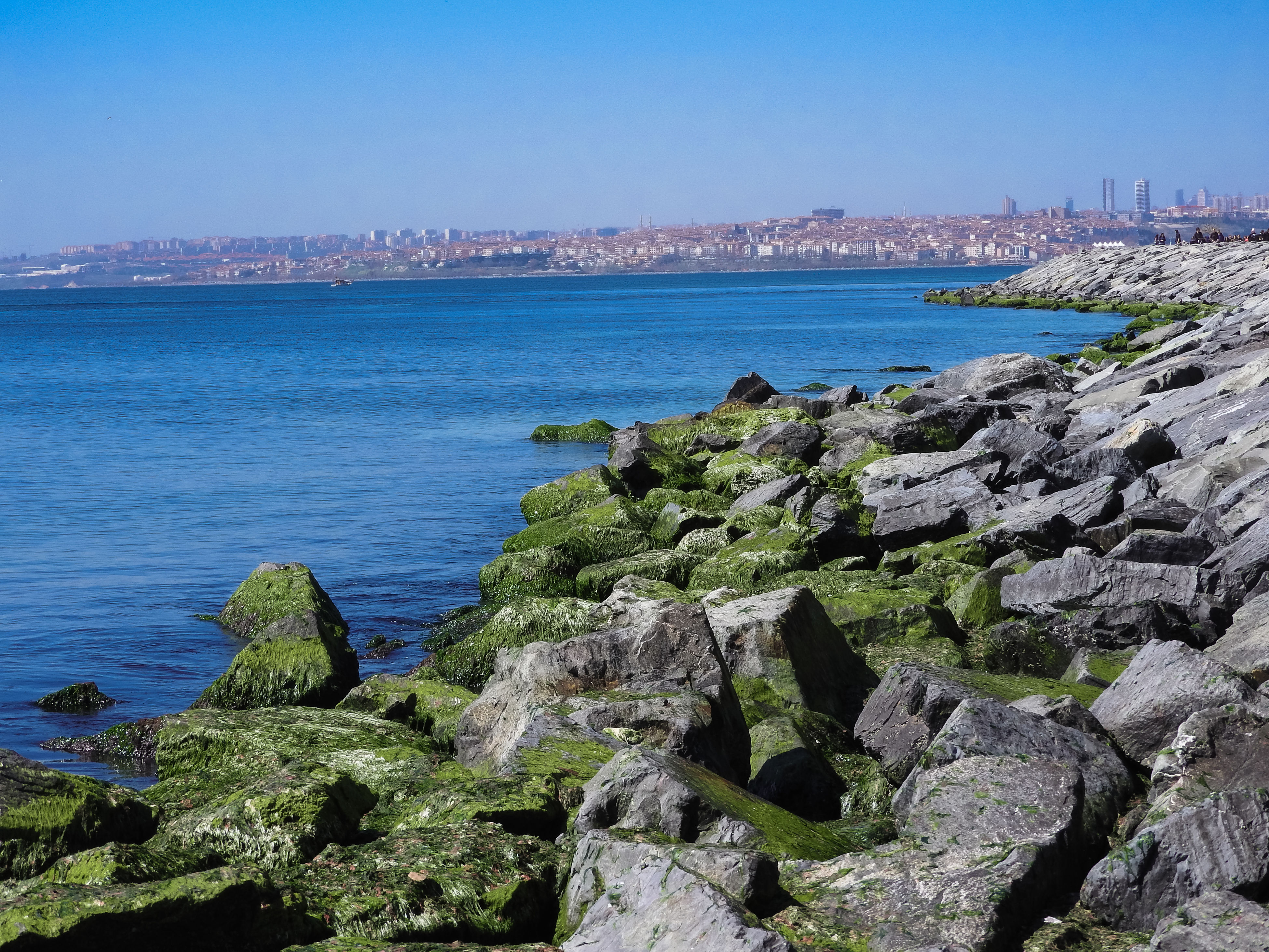 sea, water, outdoors, architecture, nature, built structure, day, clear sky, scenics, building exterior, travel destinations, no people, sky, city, cityscape, horizon over water, blue, beach, beauty in nature, skyscraper, urban skyline