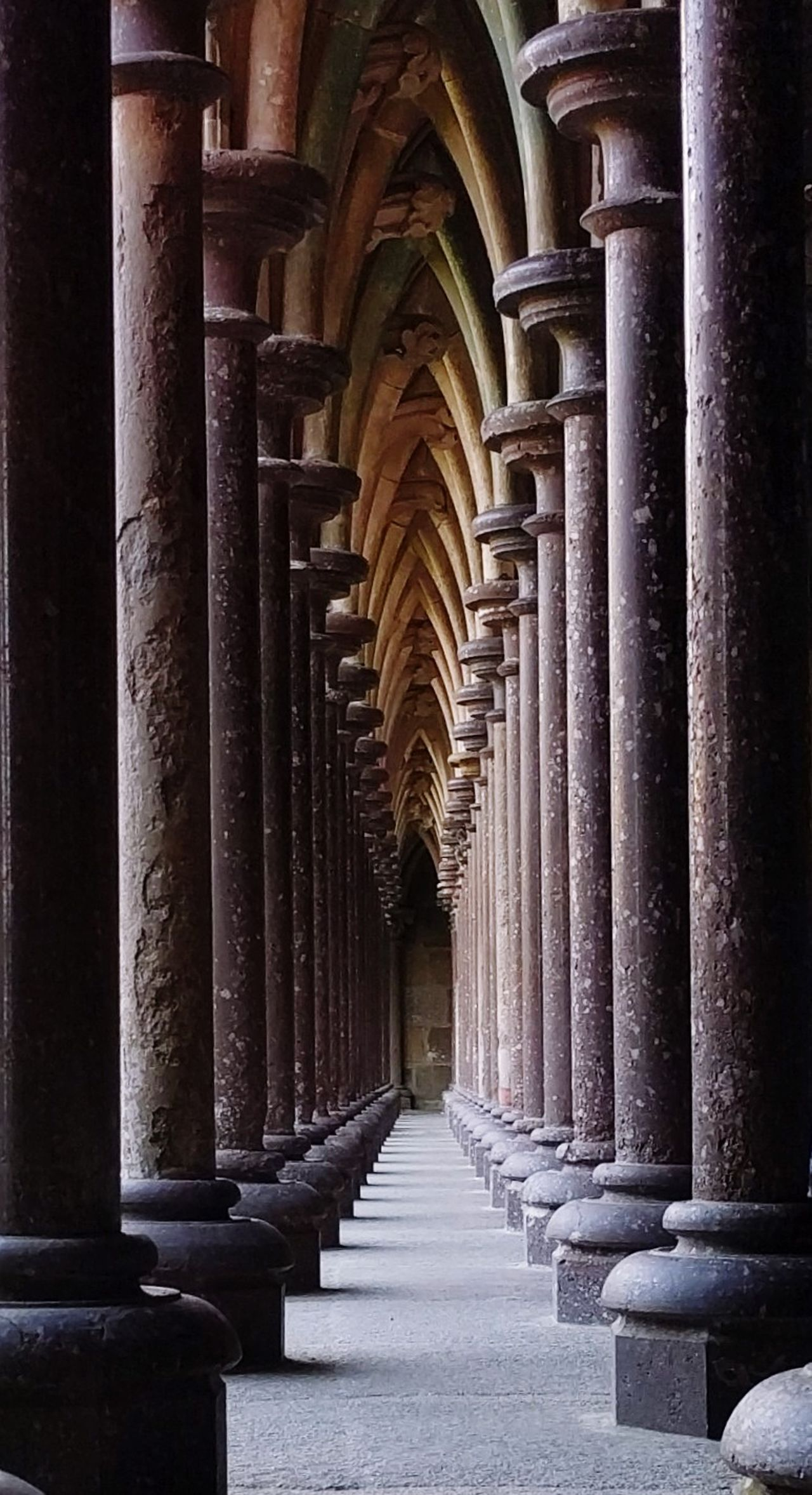 Corridor Architectural Column Colonnade History Architecture Arch In A Row Repetition Built Structure Abbey Ancient History Stone Material Sacred Places Mont St Michel Architecture Historic