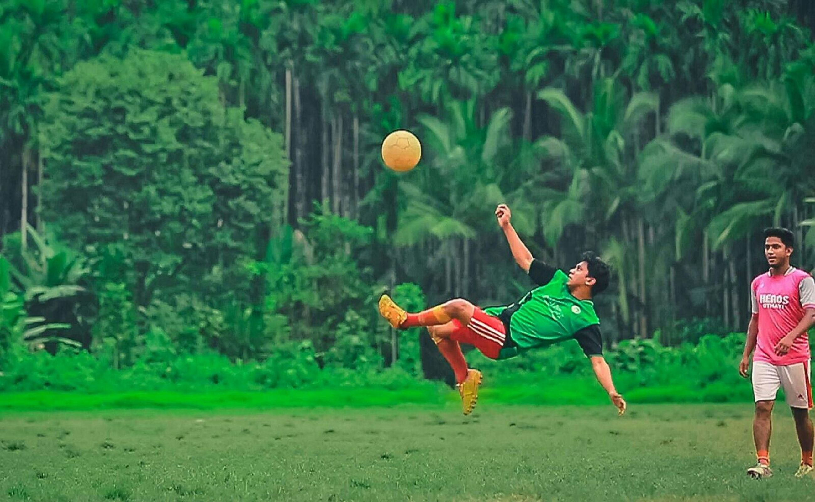 leisure activity, lifestyles, full length, childhood, casual clothing, boys, enjoyment, fun, playful, sport, mid-air, men, girls, playing, elementary age, field, togetherness