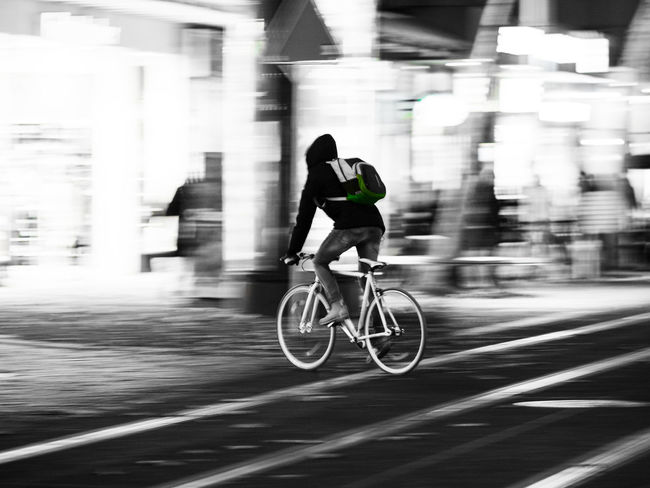 Bicycle in motion Bicycle Blackandwhite Blurred Motion City Color Spot Healthy Lifestyle Long Exposure Men Mode Of Transport Motion One Person Road Speed Sport Transportation