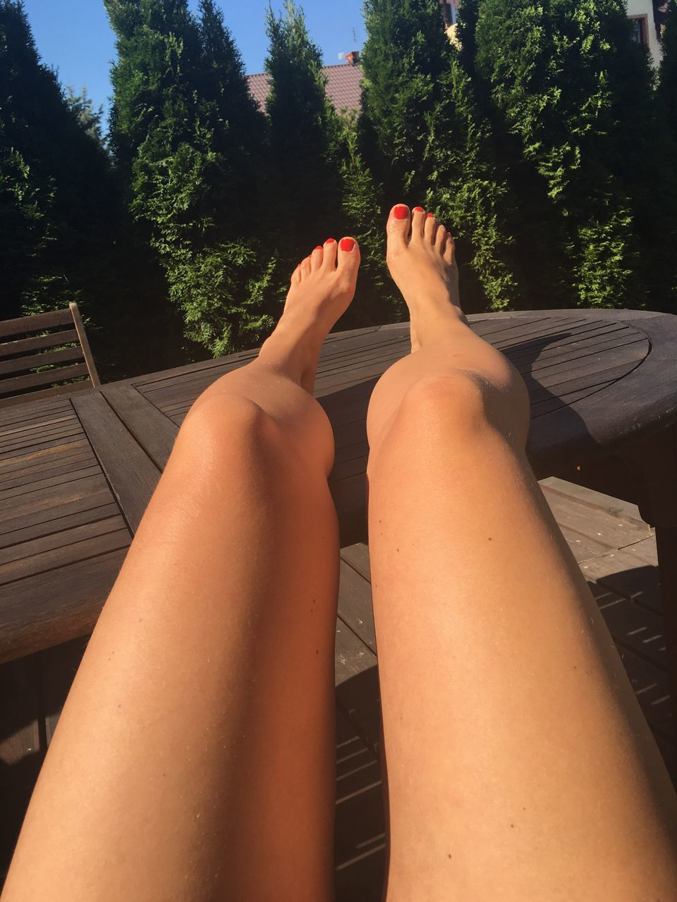 human leg, barefoot, low section, human foot, relaxation, human body part, one person, real people, sitting, outdoors, day, nail polish, nature, people