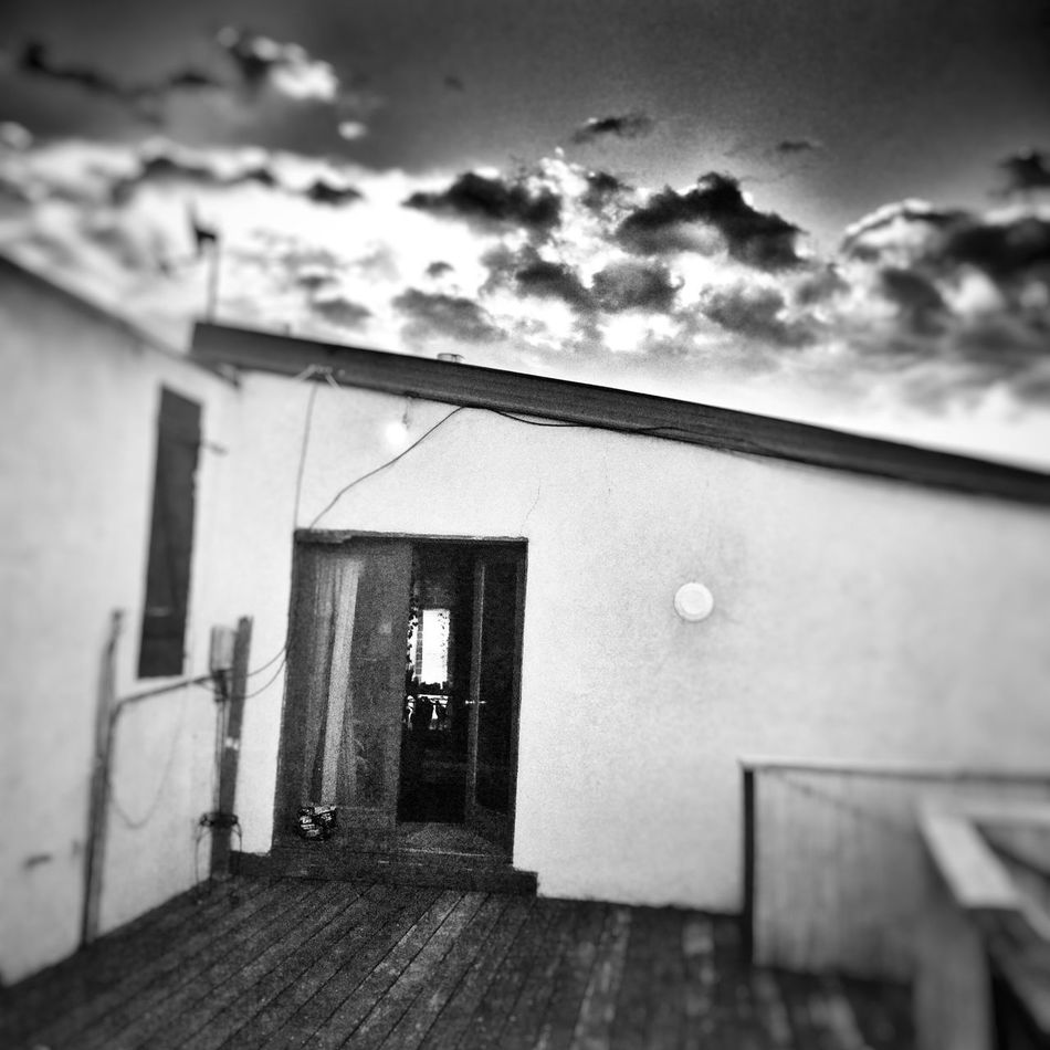 Sunset on the deck Relaxing Old Deck New Mexico Enjoying Life Hello World Wood Deck Clouds And Sky Clouds Taos New Mexico Decks New Mexico, USA Composition Blackandwhite Black And White Black & White Blackandwhite Photography Adobe Building Desert Beauty Desert Sky Northern New Mexico Square Square Format Lovers Square Format Old Door Old Doors