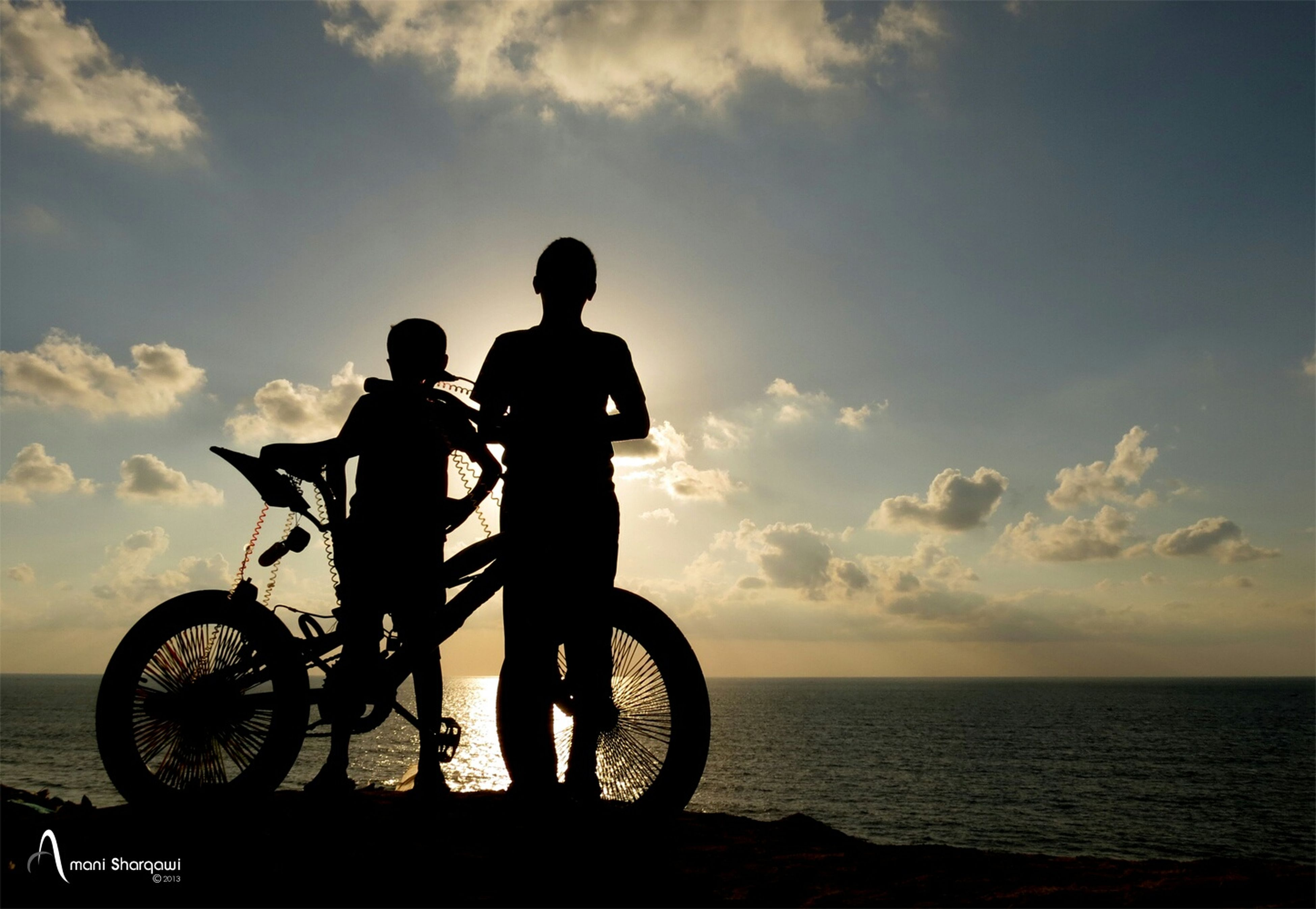 silhouette, sea, bicycle, sky, water, men, sunset, horizon over water, leisure activity, transportation, lifestyles, cloud - sky, mode of transport, beach, land vehicle, cloud, standing