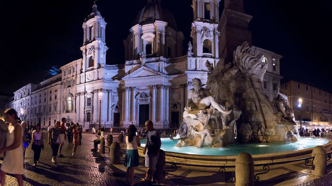 Fontana dei Quattro Fiumi, Piazza Navona one September evening 5d Mark Iv Ambient Canon Canon 5d Mark Iv Cobblestone Evening Evening Light Font Fontana Hand Held High ISO Italy Light And Shadow Navona Night Nightphotography People Piazza Roma Rome September September 2016 Tourism Water