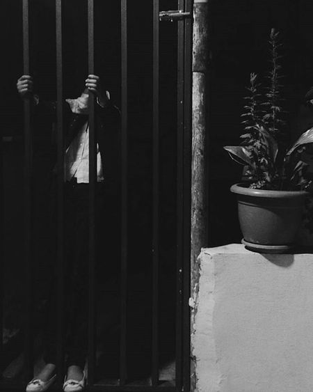 Trapped. Garden Gate Fence Iron Plants Night Citynights City Dark Shades Black Blackandwhite Dark Darkness Nyctophilia Kid Hanging Trap Alone VSCO Vscogood HTC Jordan