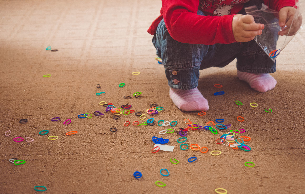 oops... Adult Braid Carpet Child Childhood Children Children Photography Close-up Colours Day Elastic Band Hands Human Body Part Indoors  Jeans Low Section Multi Colored One Person People Red