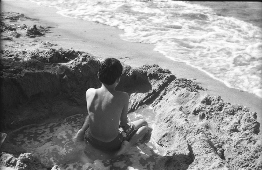 A boy playing in the sand. Analogue Photography Back View Beach Beauty In Nature Black And White Photography Black Sea Film Is Not Dead Film Photography I Still Shoot Film Kodak Tri-X Leisure Activity Nature No Face Rear View Sand Sea Sinop Sinop Turkey Summer Sunny Day Travel Travel Photography Turkey Wide Angle Zenit122