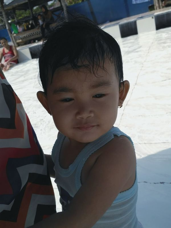 my niece, first time on swimming pool Holiday Wonogiri