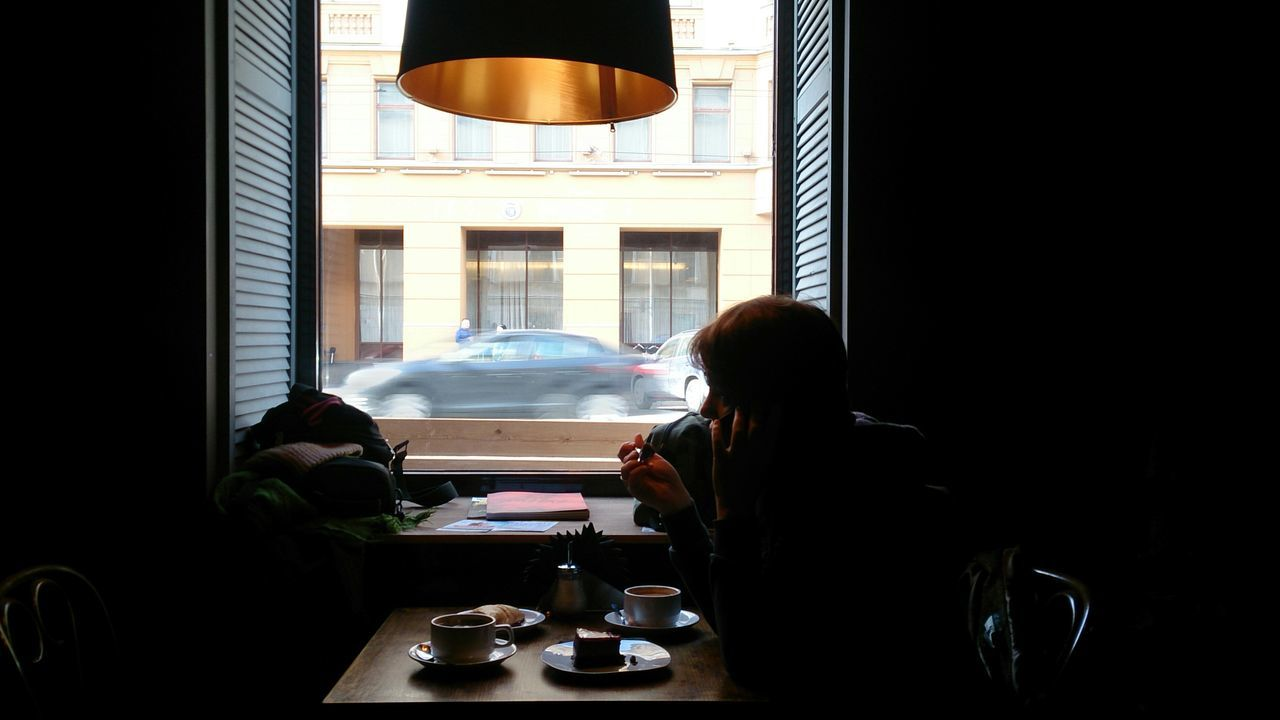 Window at Coffee Shop. Mobile Photography Sony Xperia Zr People Women Sitting Light And Shadows Shadows City Urban Light And Shadow Windows Silhouettes Coffee Coffe Time Contrast Window Light Lonely Melancholy Quiet Moments