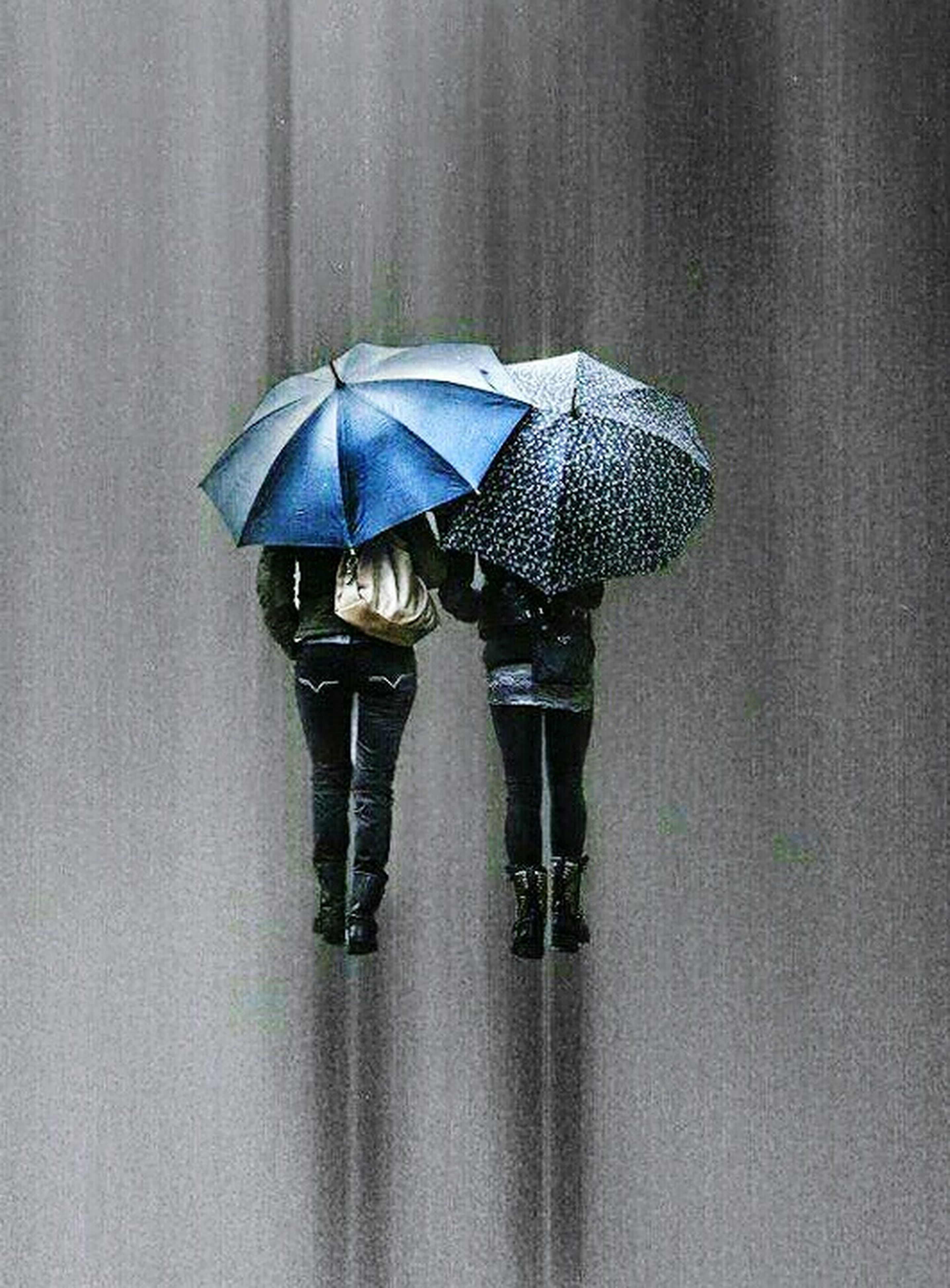 umbrella, rain, wet, protection, below, weather, rainy season, holding, full length, real people, walking, two people, water, adults only, low section, outdoors, day, people, drenched, togetherness, adult