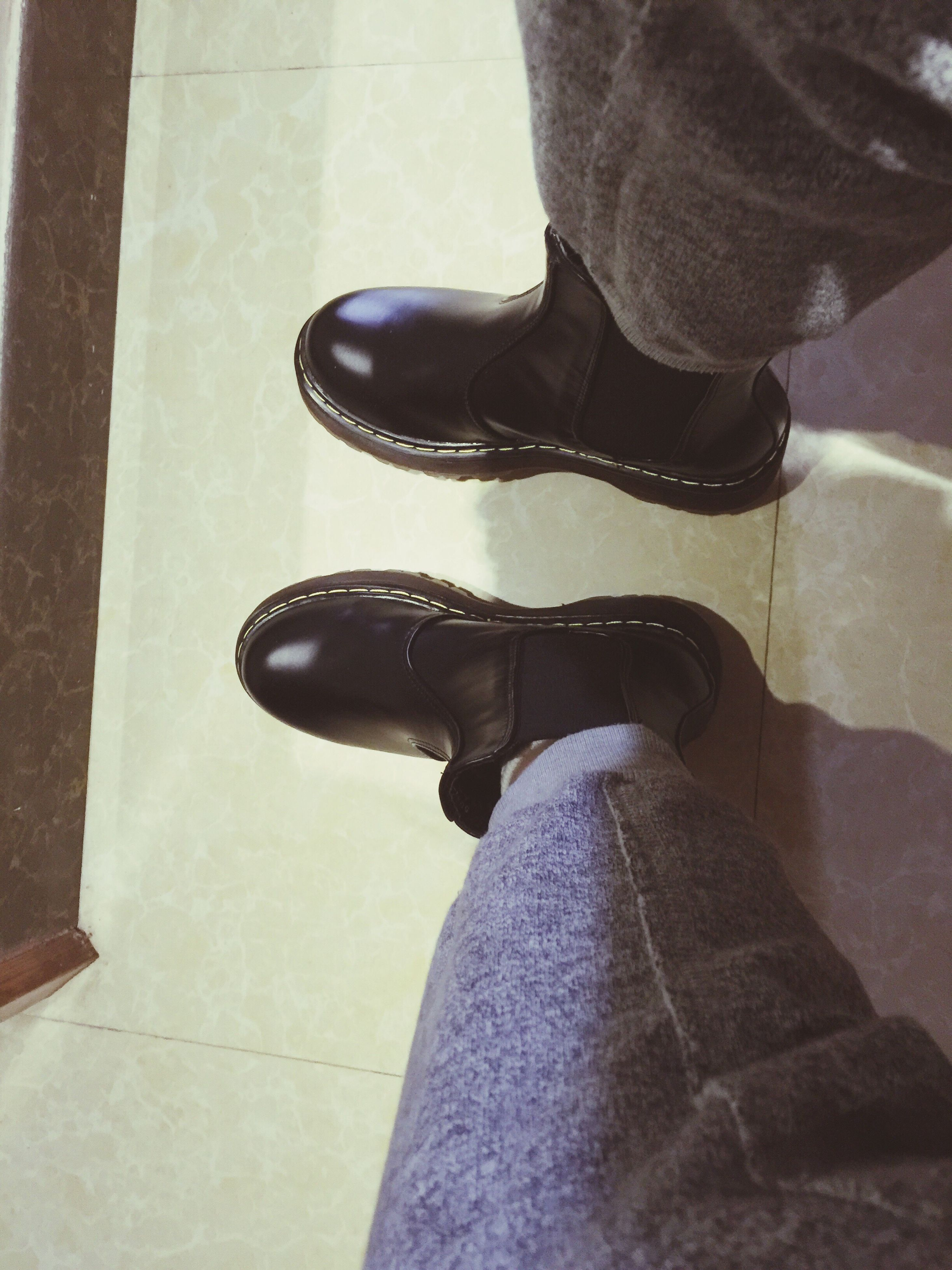 low section, person, shoe, lifestyles, indoors, human foot, standing, footwear, leisure activity, jeans, personal perspective, men, casual clothing, fashion, flooring, sitting