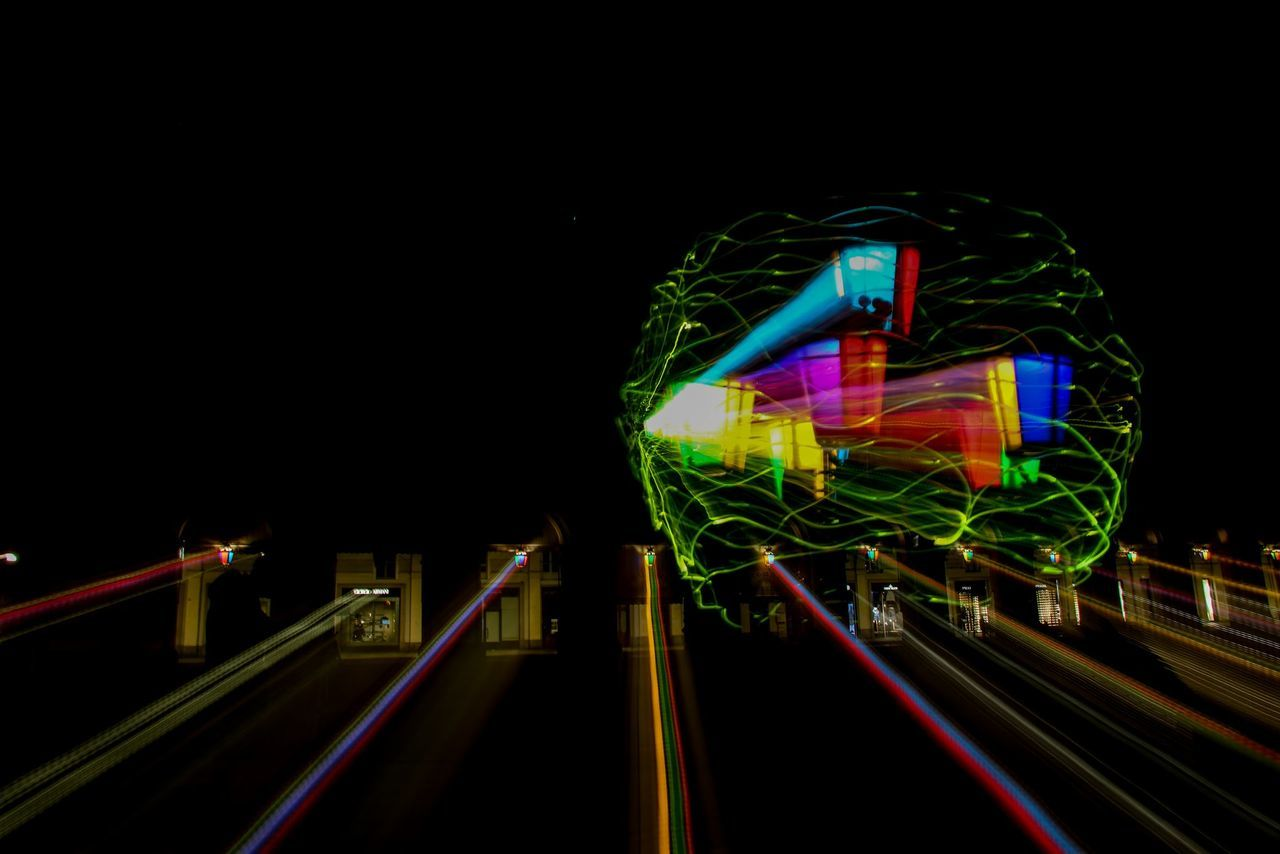 illuminated, night, multi colored, light trail, railing, long exposure, neon, amusement park, speed, outdoors, arts culture and entertainment, built structure, motion, no people, ferris wheel, architecture, sky