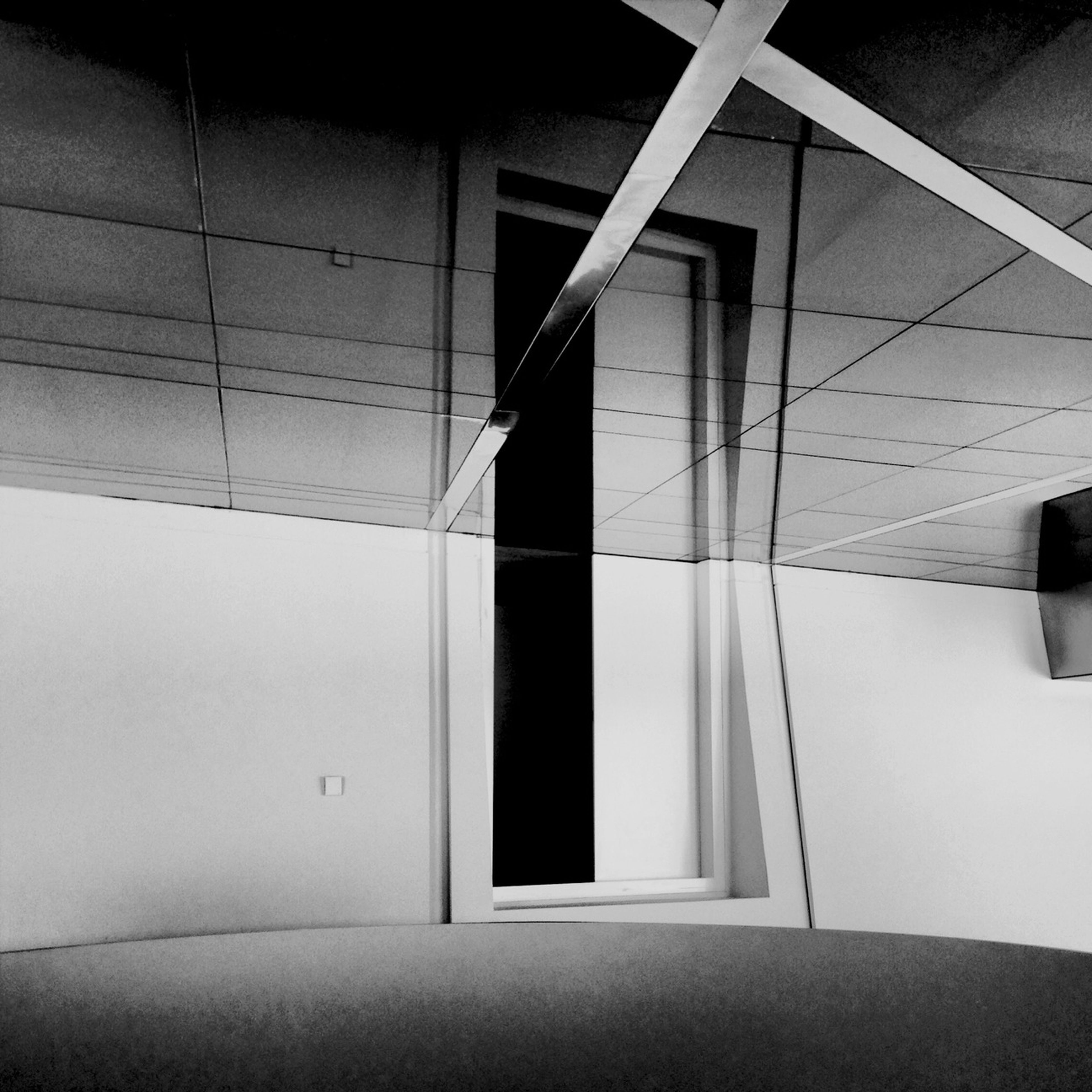architecture, built structure, building exterior, indoors, building, window, wall - building feature, sunlight, shadow, low angle view, no people, wall, day, house, modern, ceiling, door, reflection, geometric shape, absence